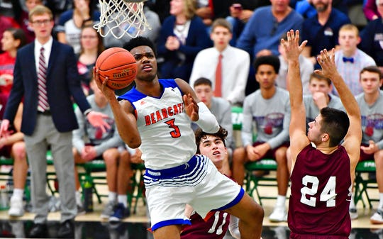 York High's Clovis Gallon Jr., front left, takes the ball to the basket while New Oxford defends during York-Adams League boys' basketball championship game action in Grumbacher Sport and Fitness Center at York College in Spring Garden Township, Friday, Feb. 15, 2019. York High would win the title game 54-50. Dawn J. Sagert photo