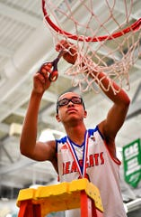 York High's Cameron Gallon, who was second on the team with 11 points, cuts down the net after the Bearcats' 54-50 win over New Oxford in the York-Adams League boys' basketball tournament championship. Dawn J. Sagert photo