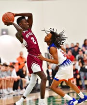 York High's Edward Minter, right, defends as New Oxford's Abdul Janneh looks to throw the ball during York-Adams League boys' basketball championship game action in Grumbacher Sport and Fitness Center at York College in Spring Garden Township, Friday, Feb. 15, 2019. York High would win the title game 54-50. Dawn J. Sagert photo