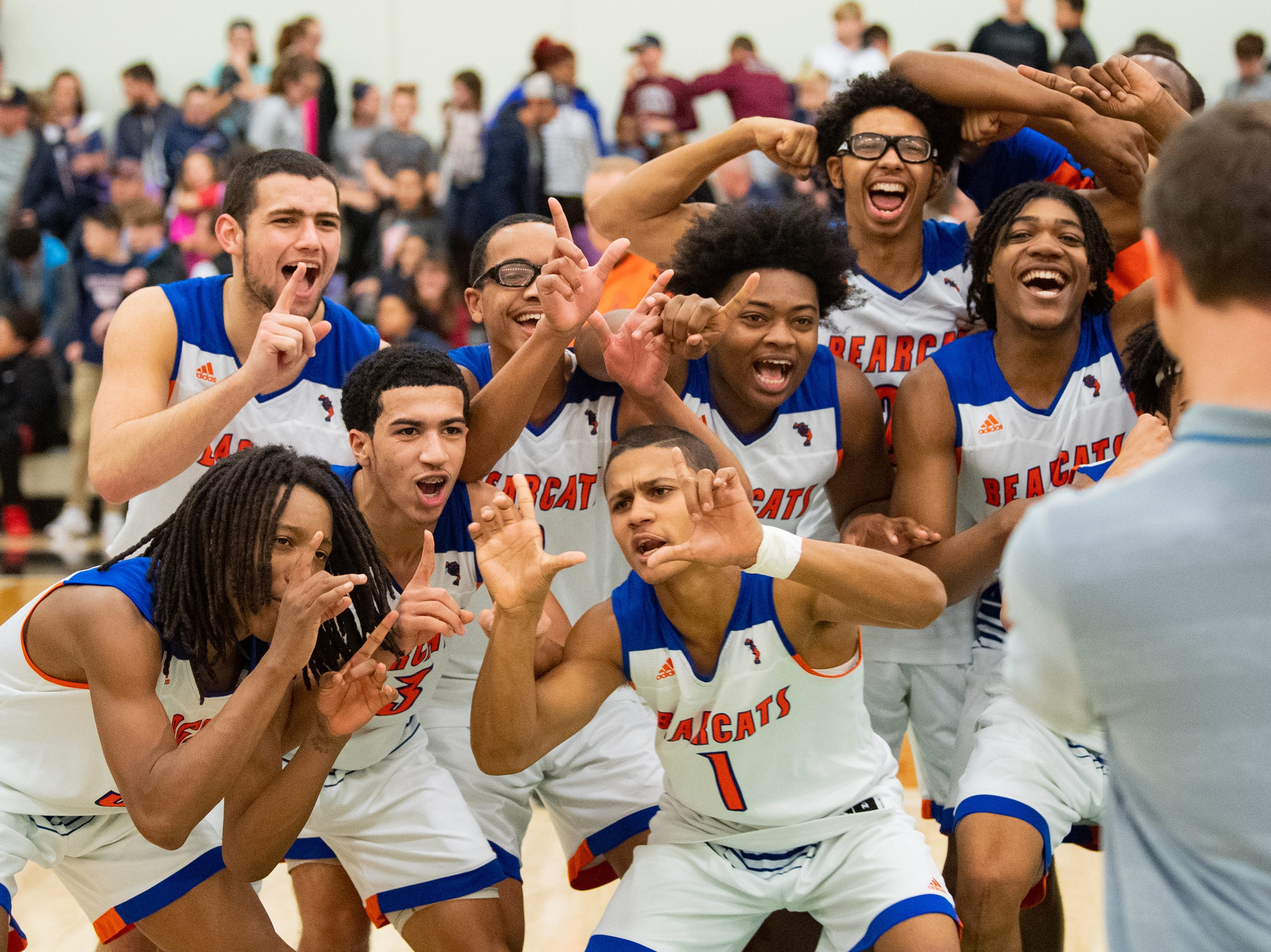 York High celebrates their tough win over New Oxford, Friday, February 15, 2019 at York College. The Bearcats defeated the Colonials 54 to 50.