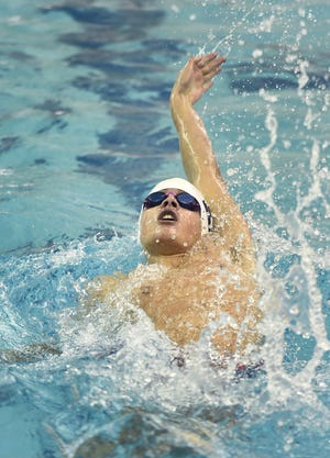 Brighton's Sam Rivera wins the final of the 100 yard backstroke with a time of 52.04 during the Section V Class B Swimming & Diving Championships at the Webster Aquatic Center, Friday, Feb. 15, 2019. Rivera finished seventh among public school participants at the state meet on Saturday.
