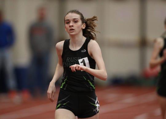 Rush-Henrietta's Haley Riorden breaks away for the win in the Class A 1000 meter run.