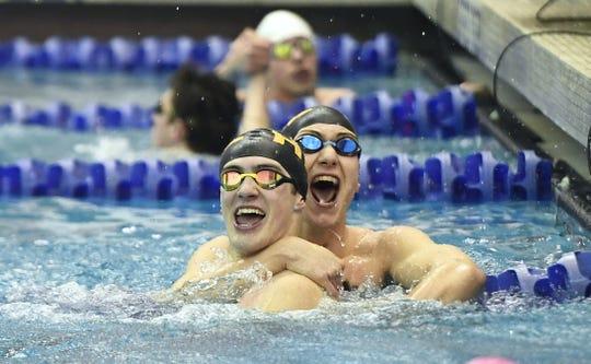 HF-L's Jackson Kammermeier, left, is congratulated by teammate Nate Grey after winning the final of the 50 yard freestyle with a time of 21.14 during the Section V Class B Swimming & Diving Championships at the Webster Aquatic Center, Friday, Feb. 15, 2019. Grey finished in second.