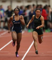Gates-Chili's Indya Richards (L) beats Jaelyn Davis in the Class A 55 meter dash.