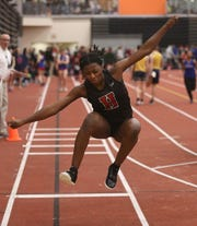 Hilton's Anaya Dees during a triple jump at last year's indoor sectionals.