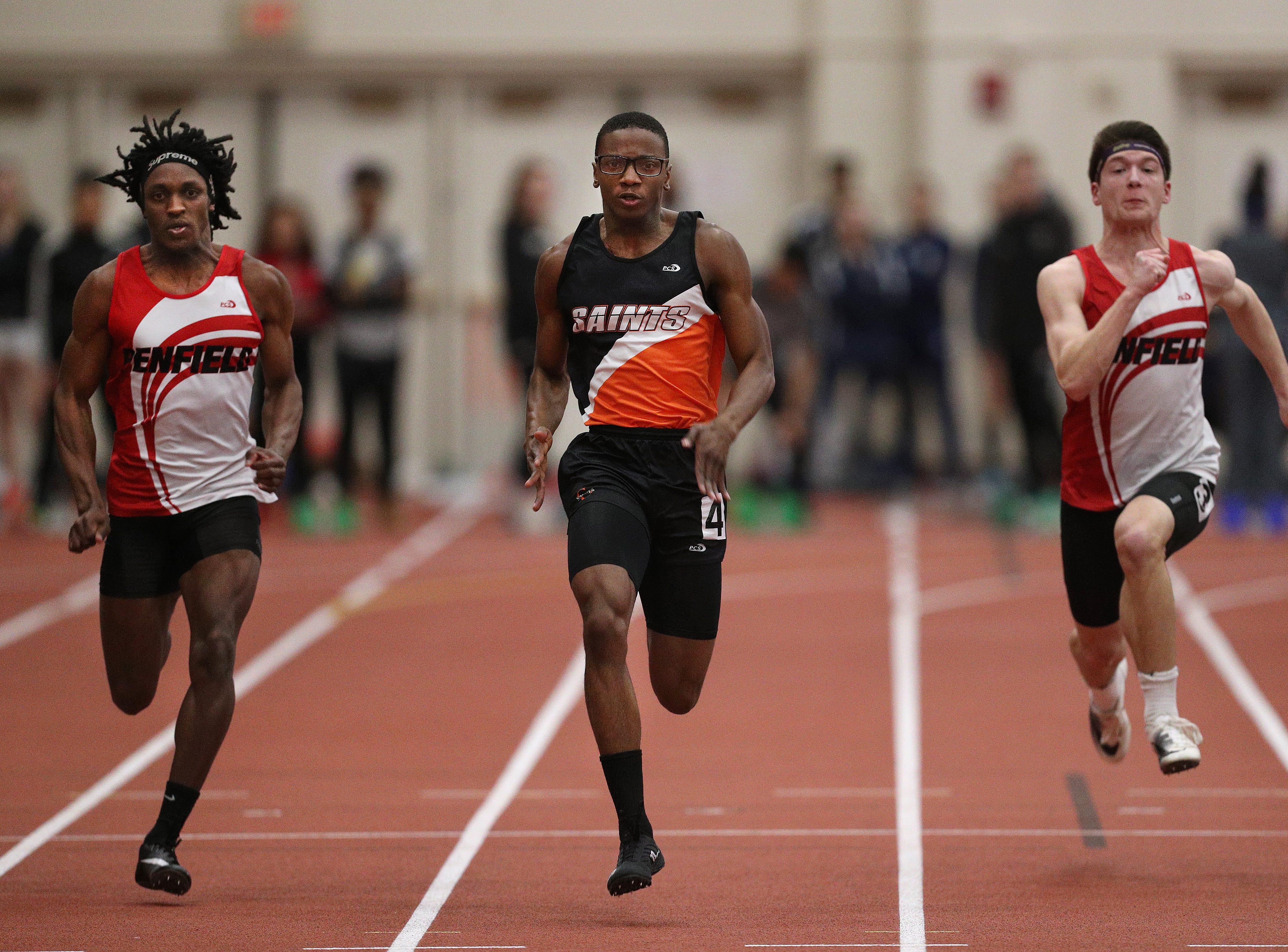 Churchville-Chili's Jaron Nesmith (center) wins the Class A 55 meter dash against Penfield's Chris Allen (L) and Joe Pizzi.