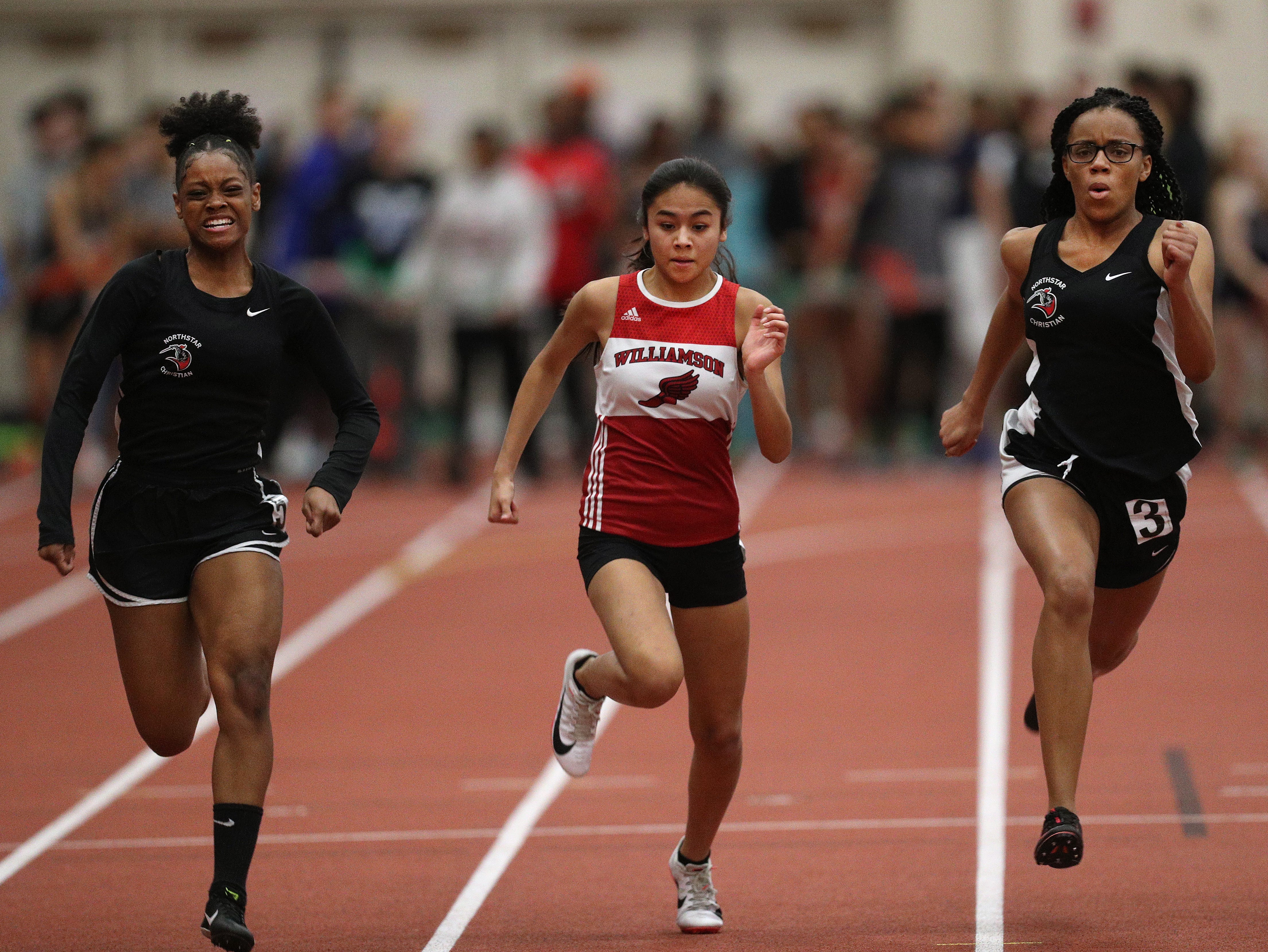 Northstar's Jasmine Smith (L) won the 55 meter dash ahead of Williamson's Andrea Hurtado and teammate Jaylon Rhone.