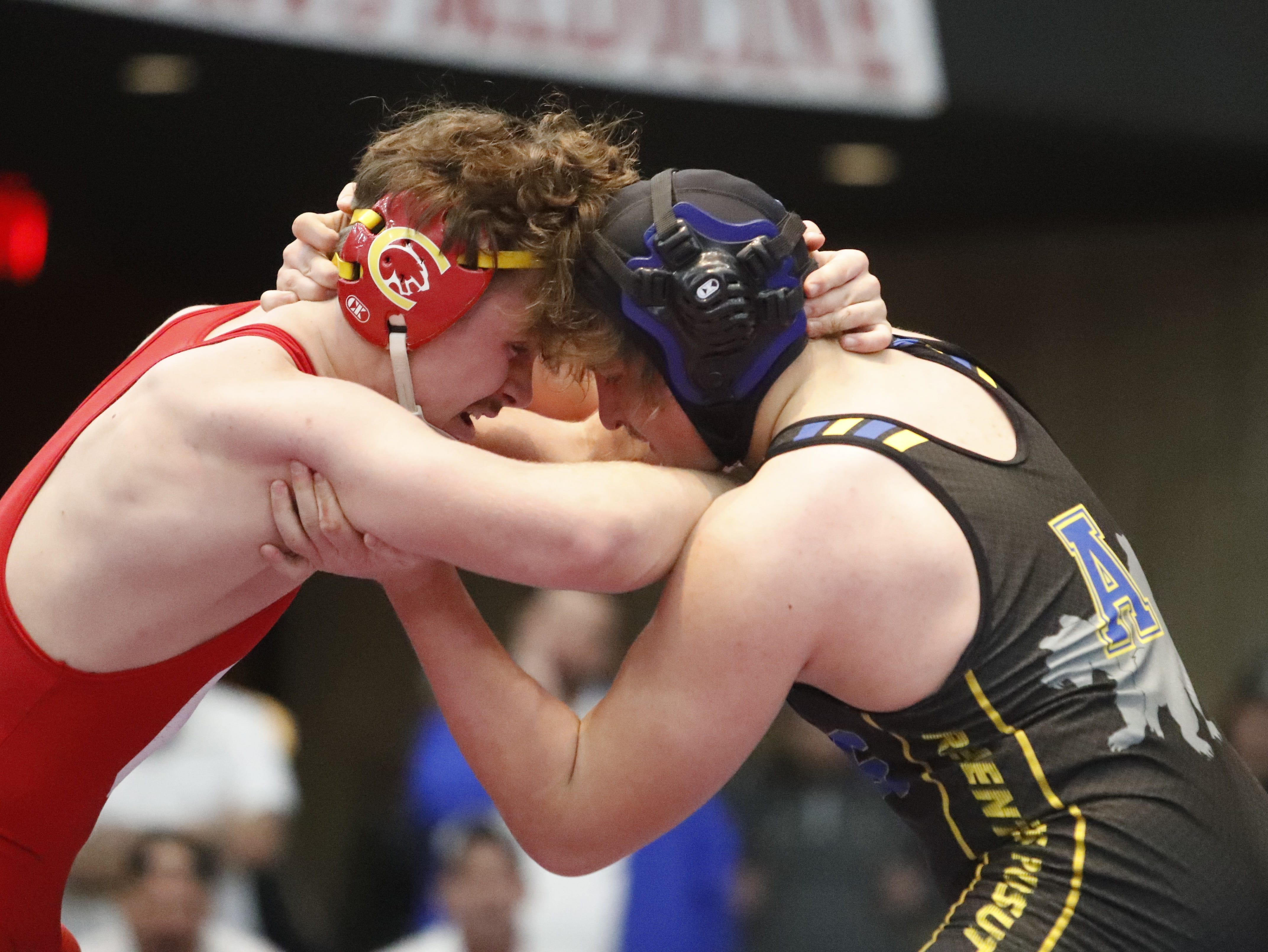Chico's Bobby McCoy (left) and Anderson's Cody Crawford grapple in the 182-pound title match at the Northern Section championships on Friday, Feb. 15, at the Redding Civic Auditorium.