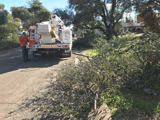 REU and other utility crews were in south Redding neighborhoods Saturday to repair damage and restore electricity following the snowstorm.