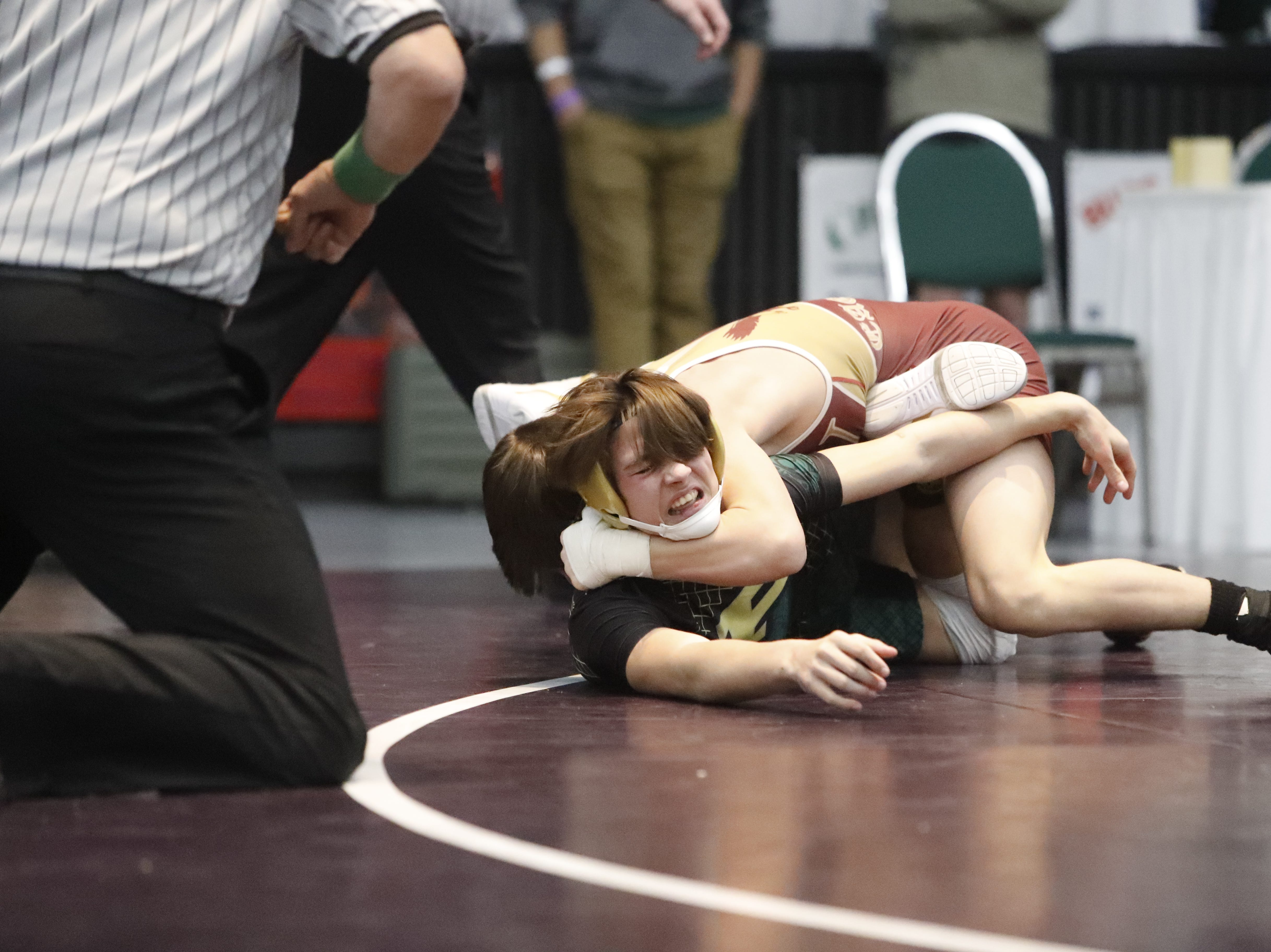 West Valley's Conner Edwards wraps up Paradise wrestler Stetson Morgan in the 120-pound third-place match at the Northern Section championships on Friday, Feb. 15, at the Redding Civic Auditorium.