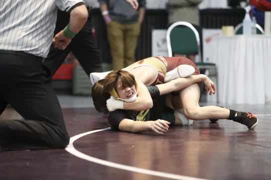 West Valley's Connor Edwards wraps up Paradise wrestler Stetson Morgan in the 120-pound third-place match at the Northern Section championships on Feb. 15, 2019 at the Redding Civic Auditorium