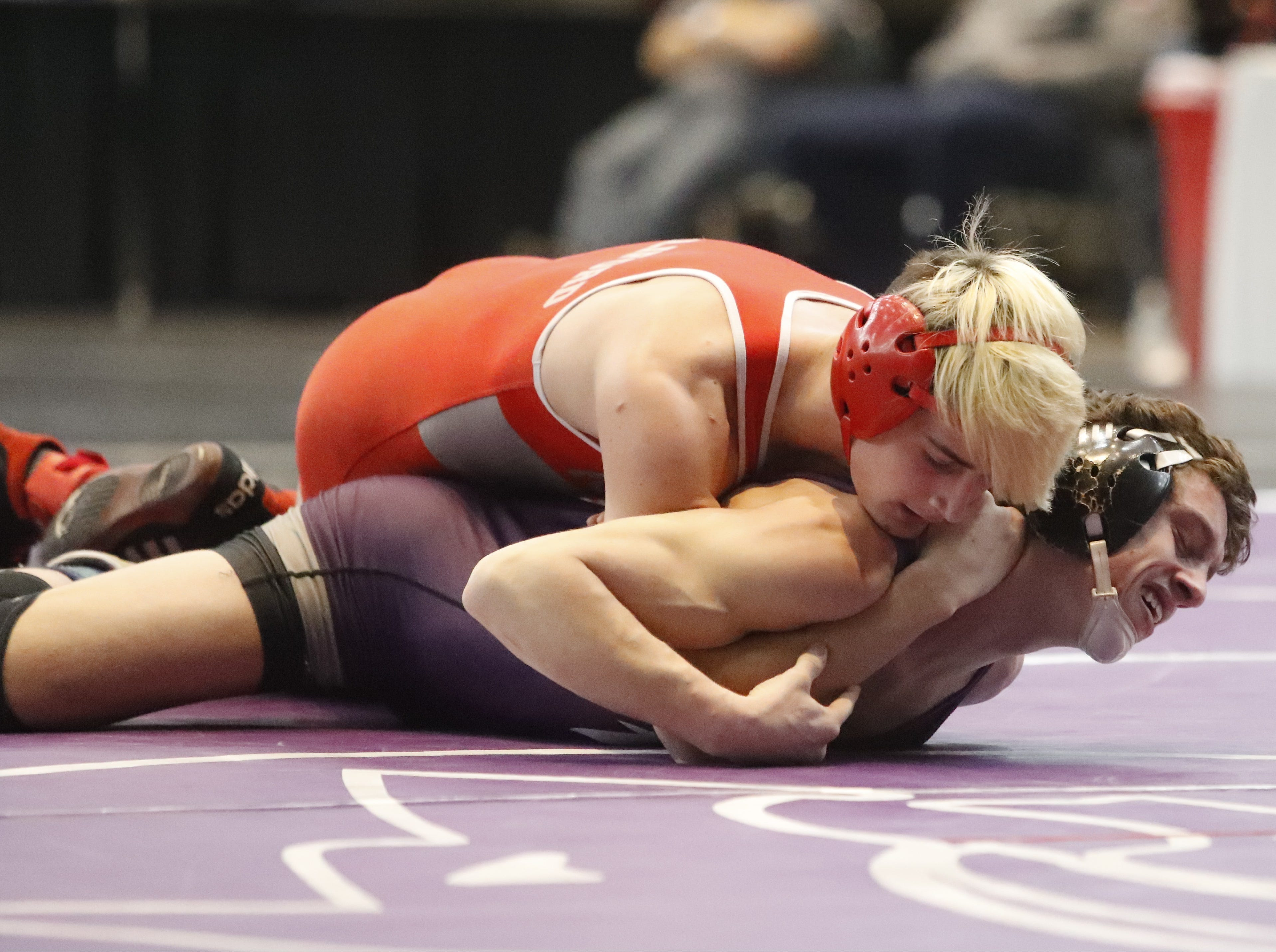 Foothill's Corey Williford (above) grapples with Shasta's Aydin Facey in the 152-pound championship semifinals of the Northern Section Masters meet on Friday, Feb. 15, at the Redding Civic Auditorium.