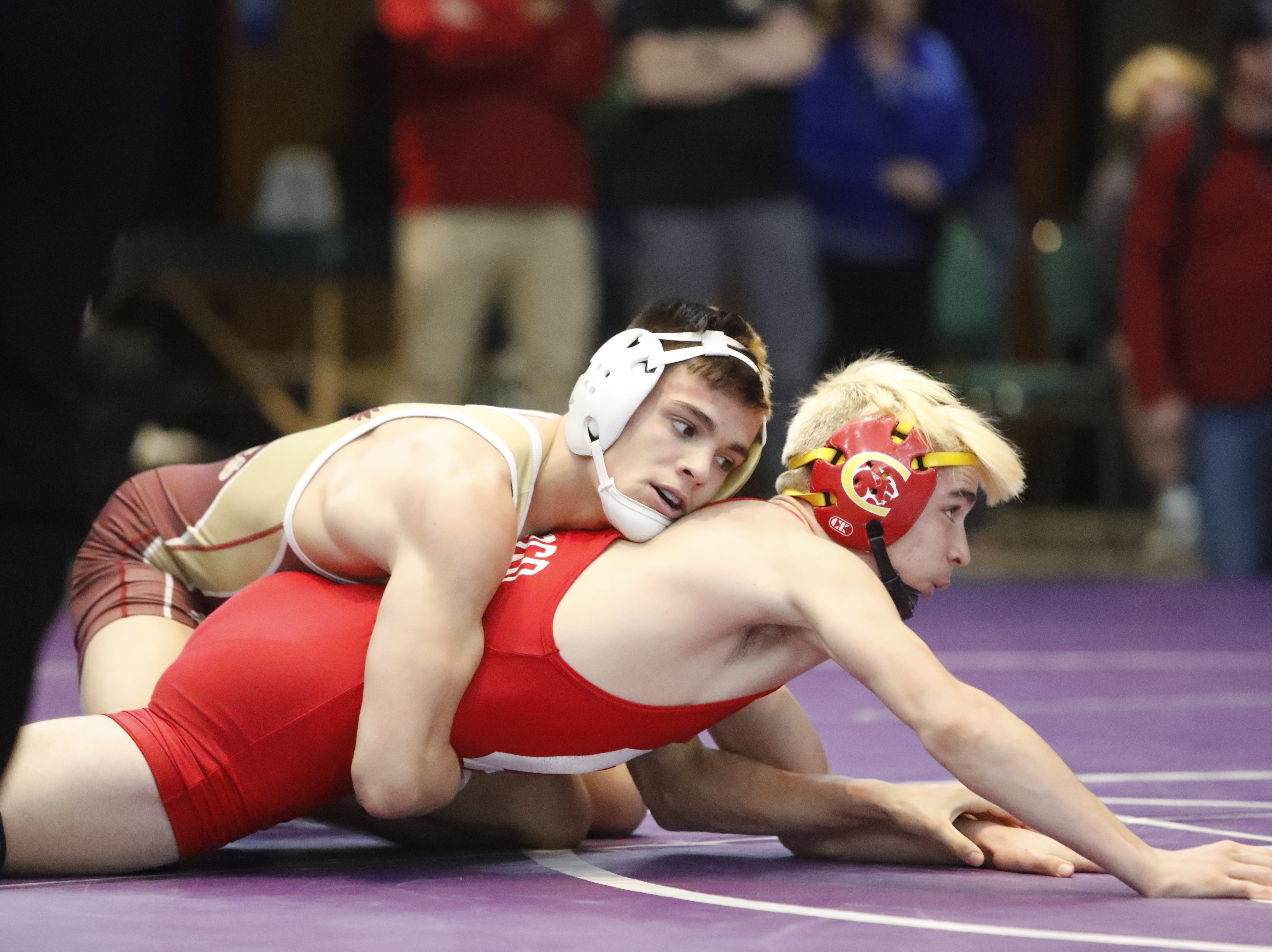 West Valley's Rocky Raby (left) grapples with Chico's Alex Rudkin on his way to winning the 132-pound Northern Section championship on Friday, Feb. 15, at the Redding Civic Auditorium.