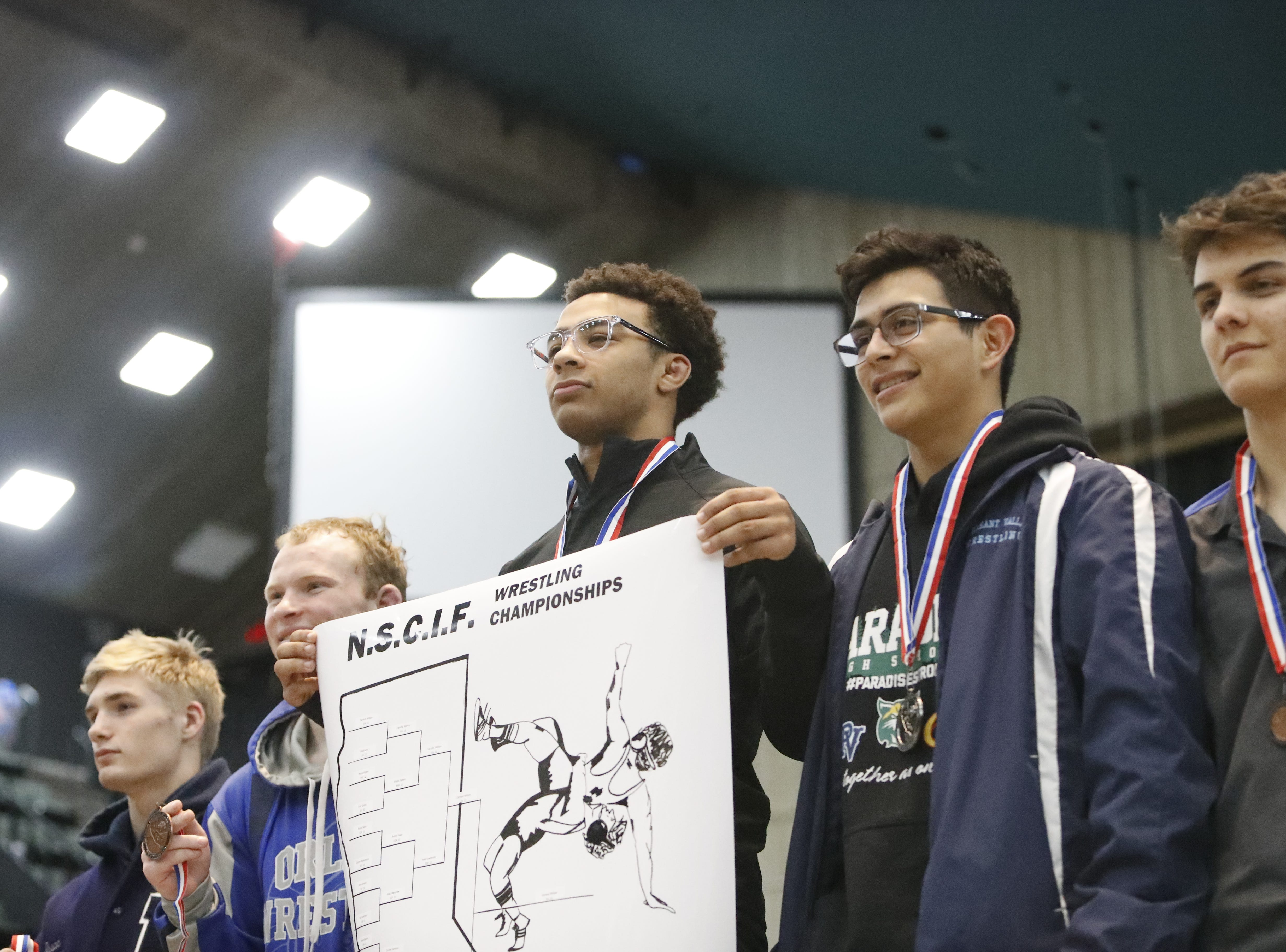 Foothill's Earnest Wilson poses after winning the 145-pound Northern Section championship on Friday, Feb. 15, at the Redding Civic Auditorium.