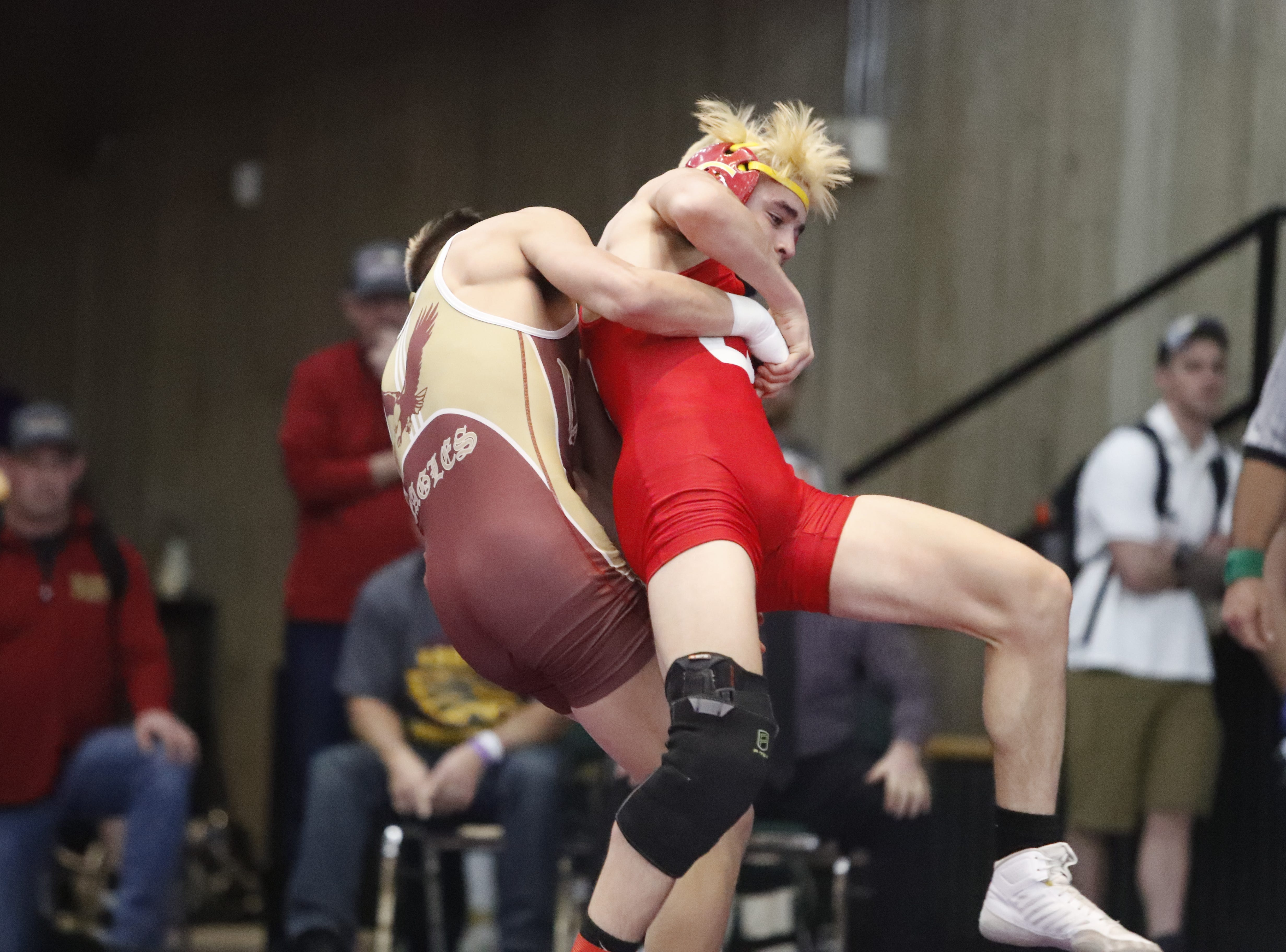 West Valley's Rocky Raby (left) tries to bring down Chico's Alex Rudkin to win the 132-pound Northern Section championship on Friday, Feb. 15, at the Redding Civic Auditorium.