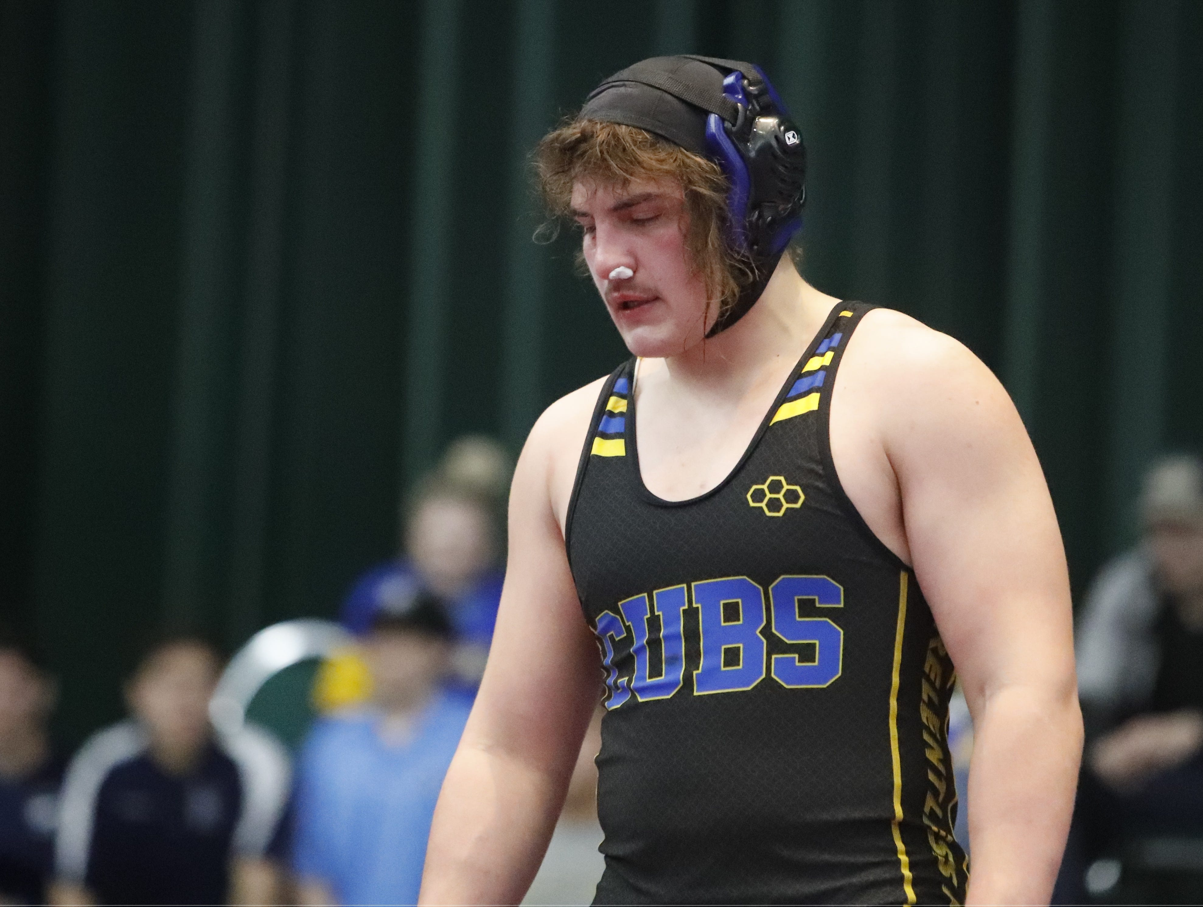 Anderson 182-pound wrestler Cody Crawford walks around the mat between rounds at Northern Section championships on Friday, Feb. 15, at the Redding Civic Auditorium.