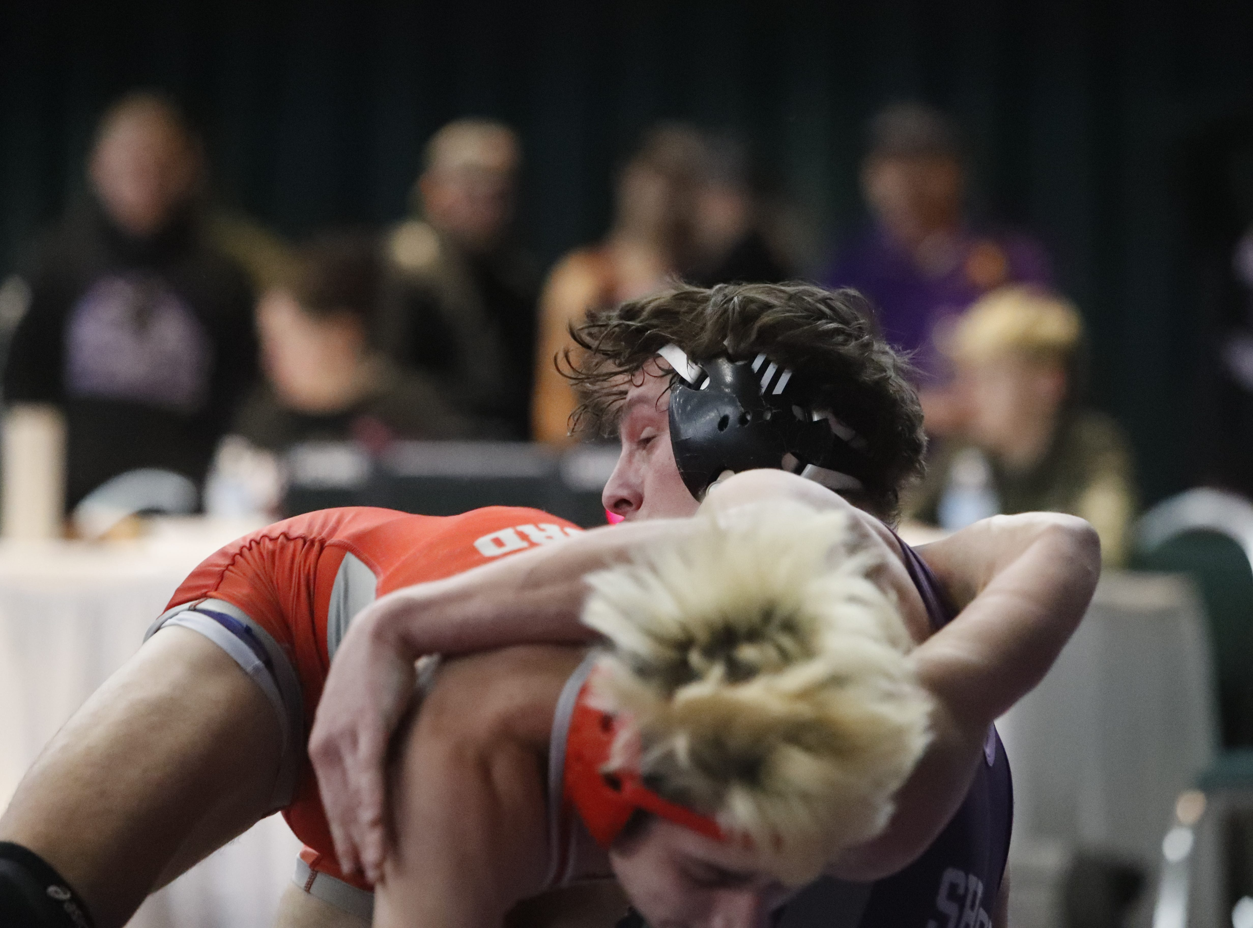Shasta's Aydin Facey (above) and Foothill's Corey Williford wrestle in the 152-pound semifinals at the Northern Section championships on Friday, Feb. 15, at the Redding Civic Auditorium.