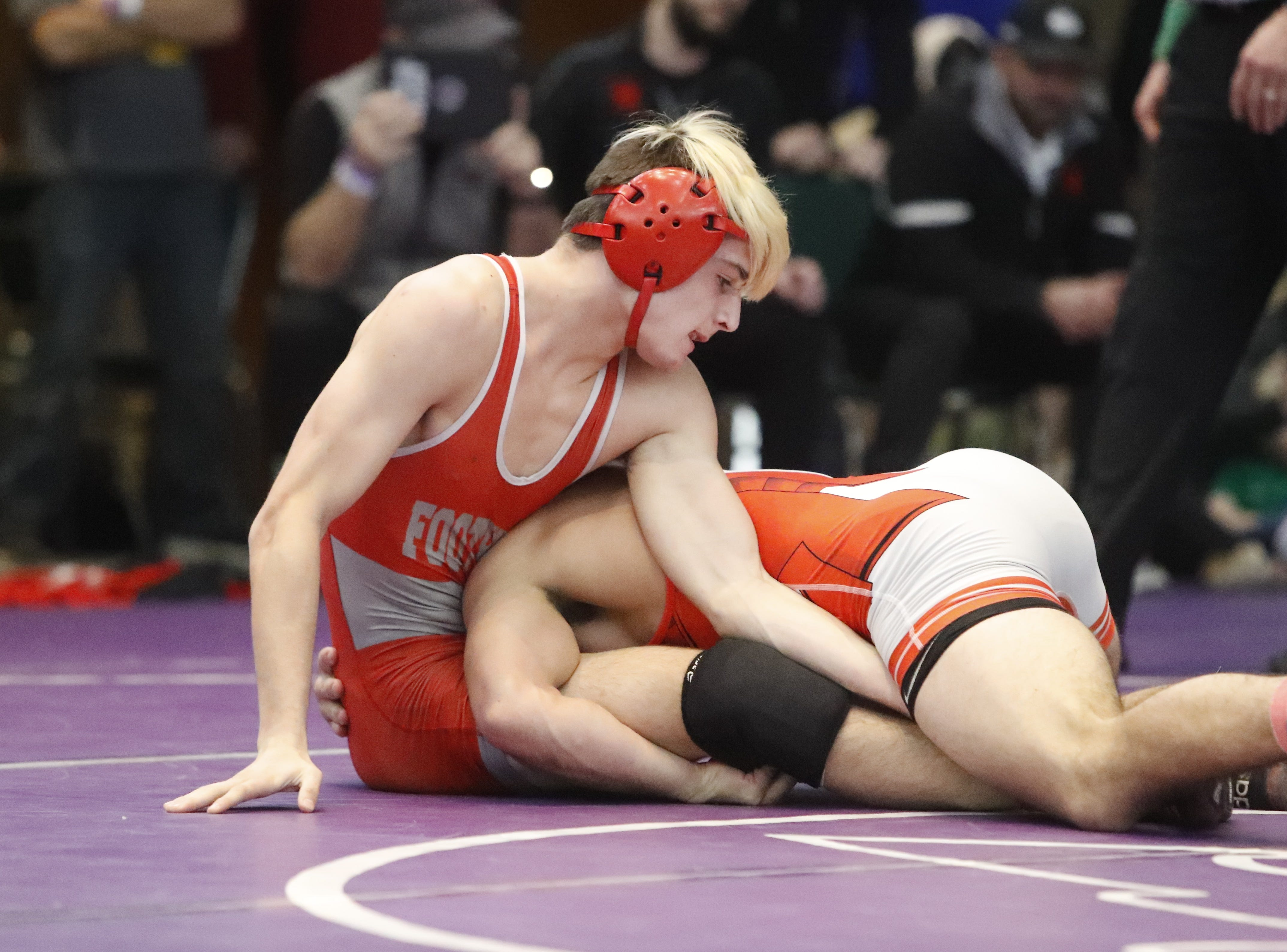 Foothill's Corey Williford (left) battles for the 152-pound title with JT Stinson of East Nicolaus at the Northern Section championships on Friday, Feb. 15, at the Redding Civic Auditorium.
