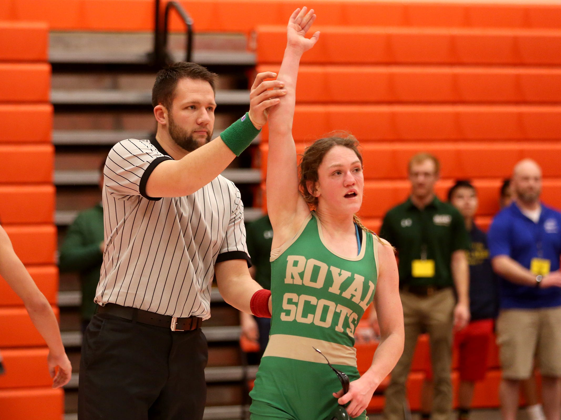 McKay's Tess Barnett wins her match in the 129 pound weight class during the Mountain Valley Conference district wrestling tournament at Sprague High School in Salem on Friday, Feb. 15, 2019.