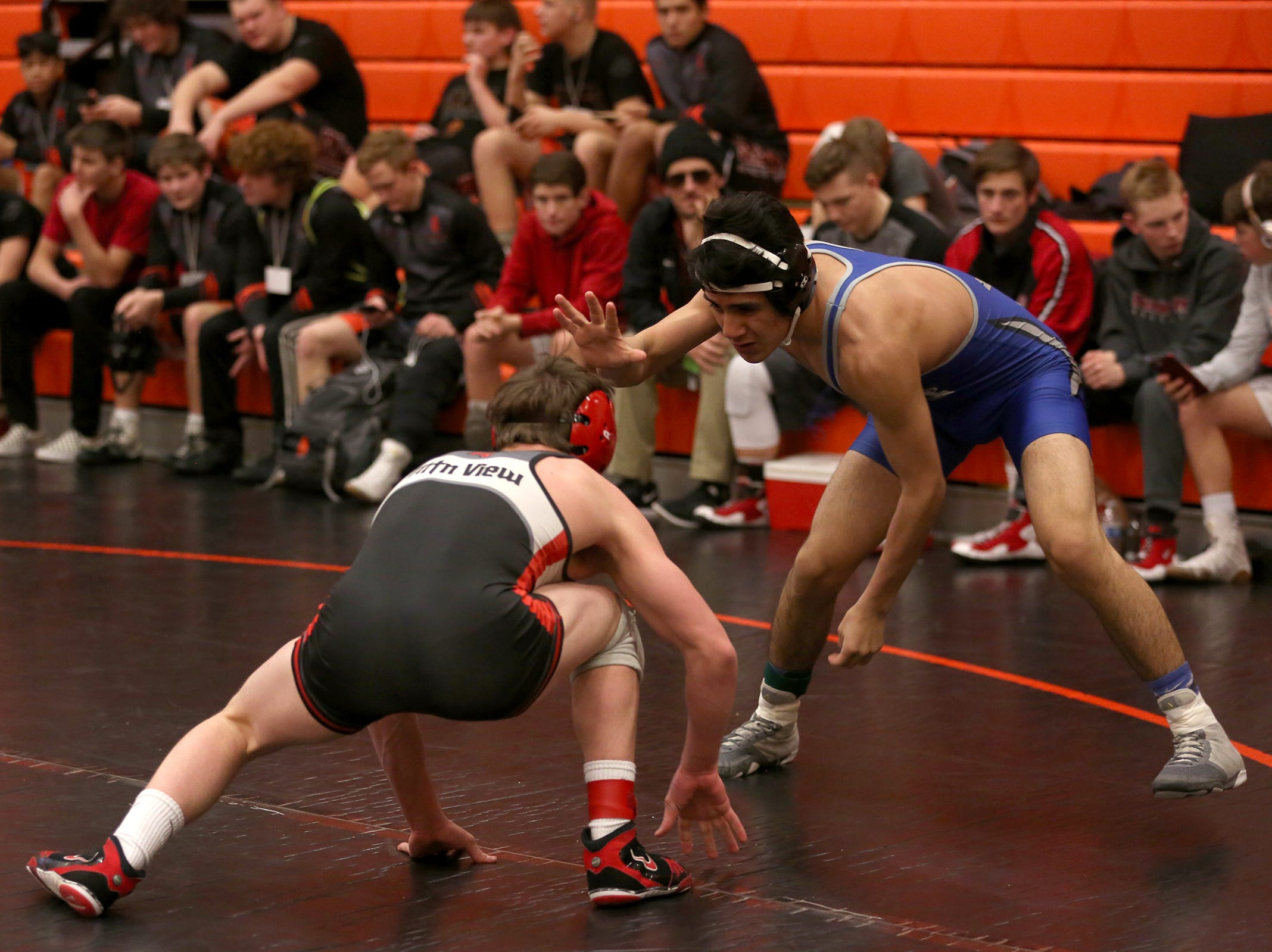McNary's Giovanni Cervantes (right) takes on Mountain View's Beau Olson as they compete in the 138 pound weight class during the Mountain Valley Conference district wrestling tournament at Sprague High School in Salem on Friday, Feb. 15, 2019.