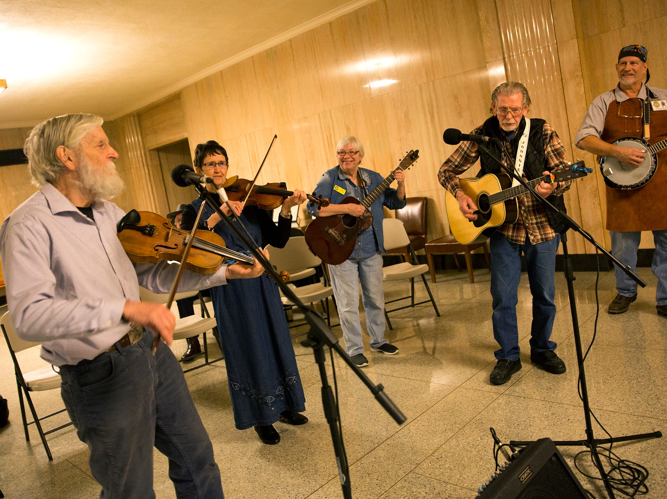Oregon Old Time Fiddlers play in front of the Senate Chambers during Oregon's 160th Birthday Celebration at the Oregon State Capitol in Salem on Saturday, Feb. 16, 2019.
