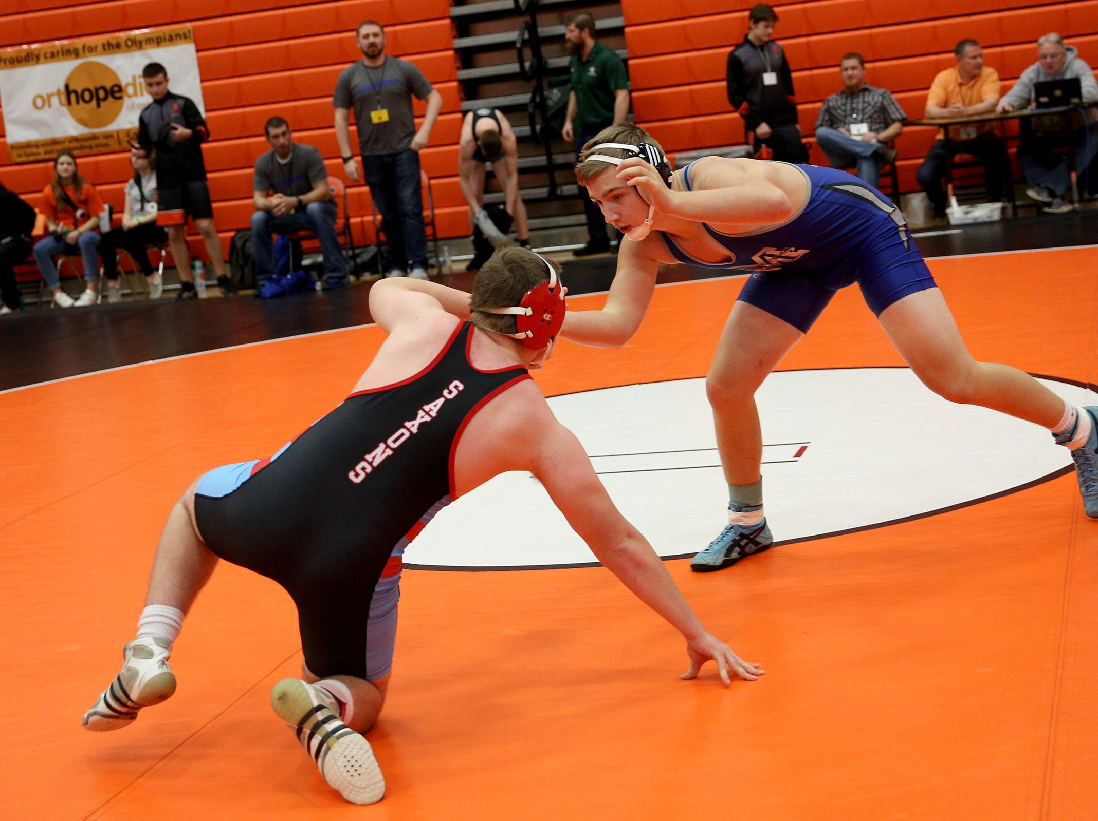 McNary's Ryan Bamford (right) takes on South Salem's Joel Bird in the 170 pound weight class during the Mountain Valley Conference district wrestling tournament at Sprague High School in Salem on Friday, Feb. 15, 2019.