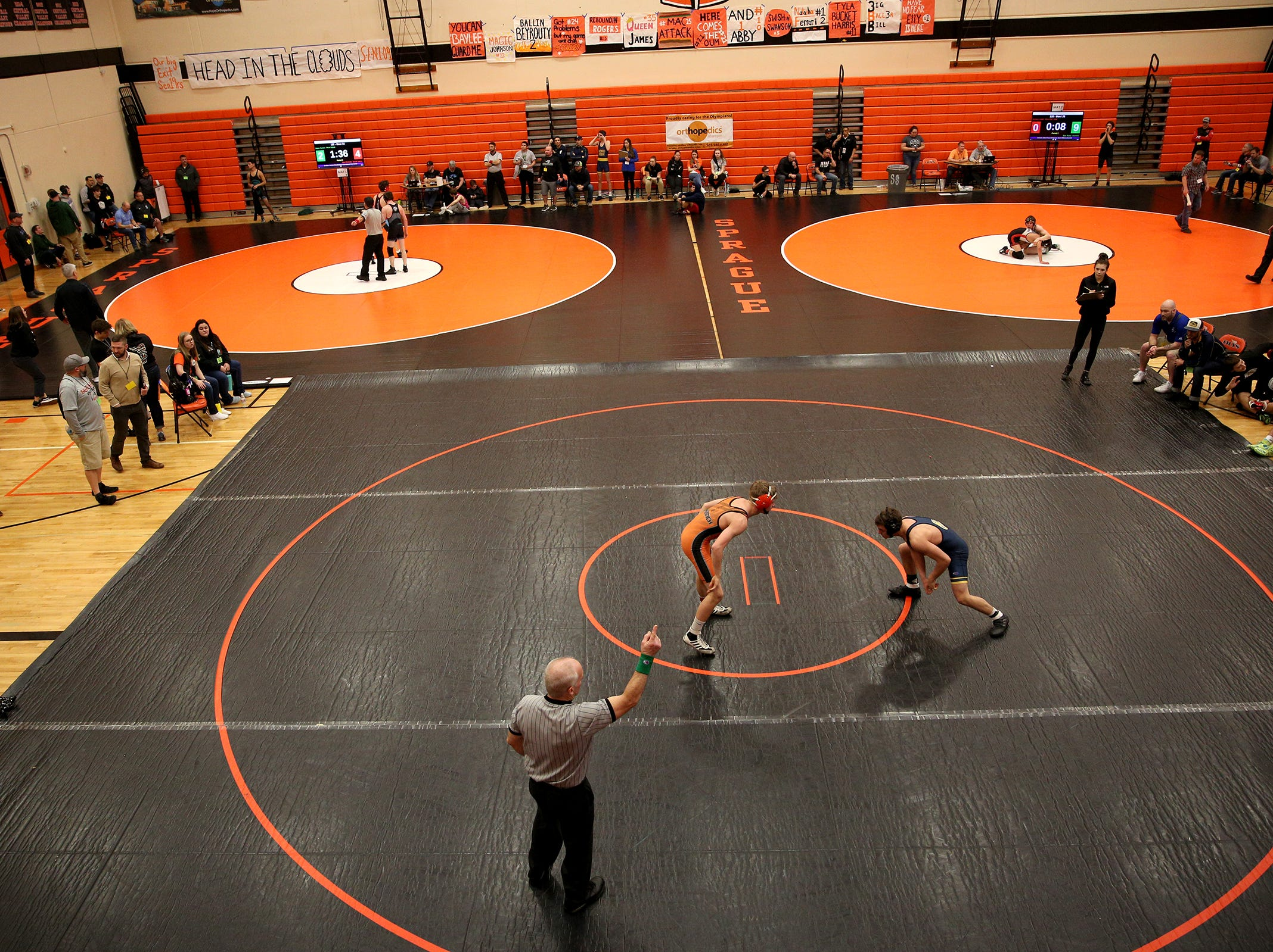 Bend's Kellen Murphy and Sprague's Luke Merzenich (up front) compete during the Mountain Valley Conference district wrestling tournament at Sprague High School in Salem on Friday, Feb. 15, 2019.