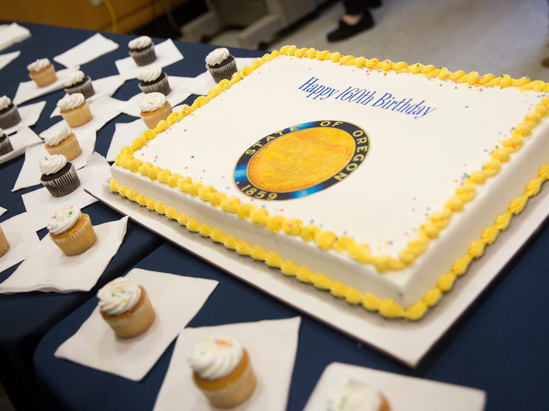 Birthday cake and cupcakes are served during Oregon's 160th Birthday Celebration at the Oregon State Capitol in Salem on Saturday, Feb. 16, 2019.