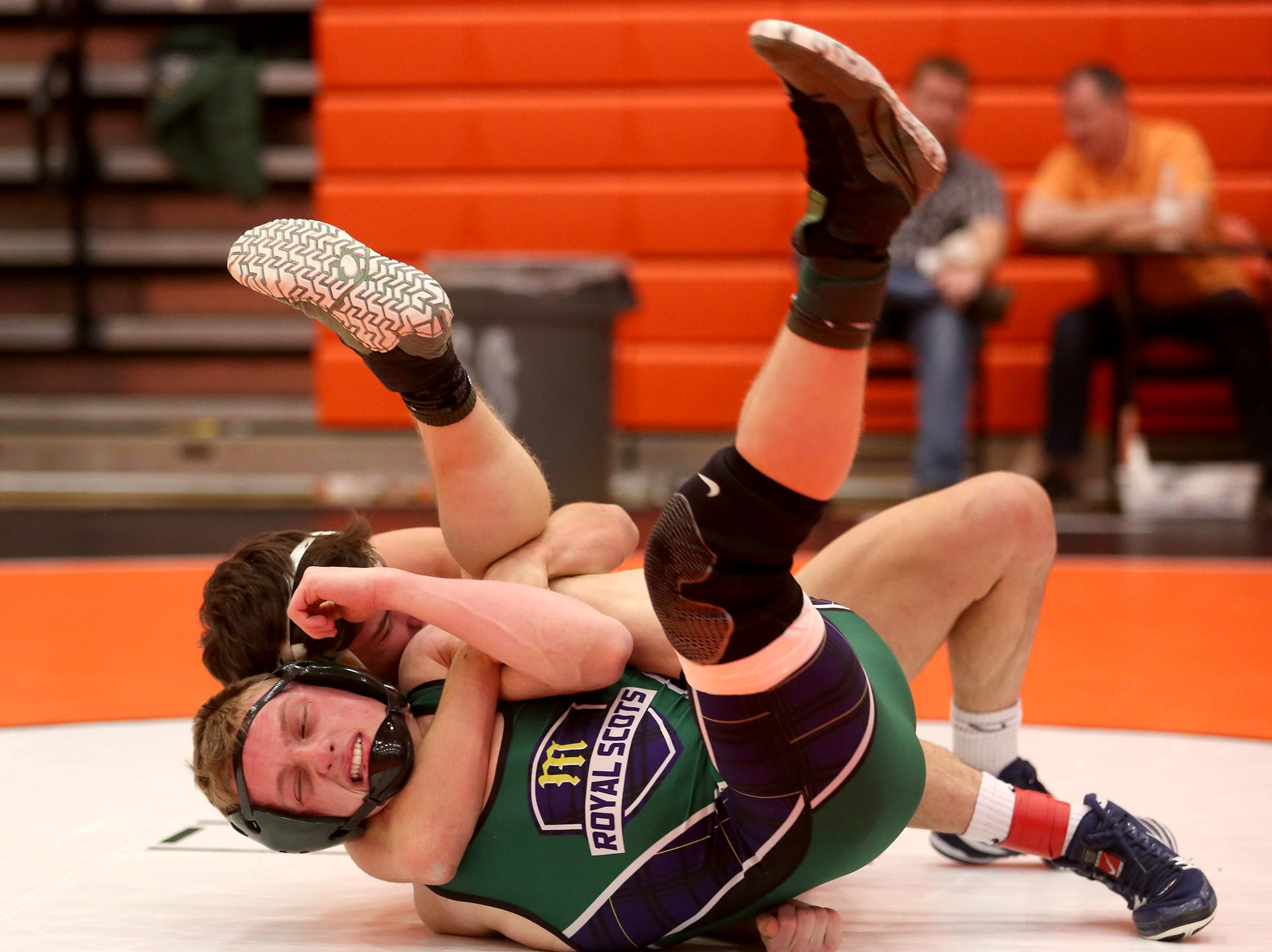 Bend's James Anderson holds on to McKay's Mitchell Everetts as they compete in the 132 pound weight class during the Mountain Valley Conference district wrestling tournament at Sprague High School in Salem on Friday, Feb. 15, 2019.