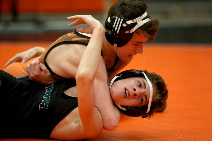 Sprague's Bo Davis holds West Salem's Brett McClung in a head lock during the 106 pound weight class during the Mountain Valley Conference district wrestling tournament at Sprague High School in Salem on Friday, Feb. 15, 2019.