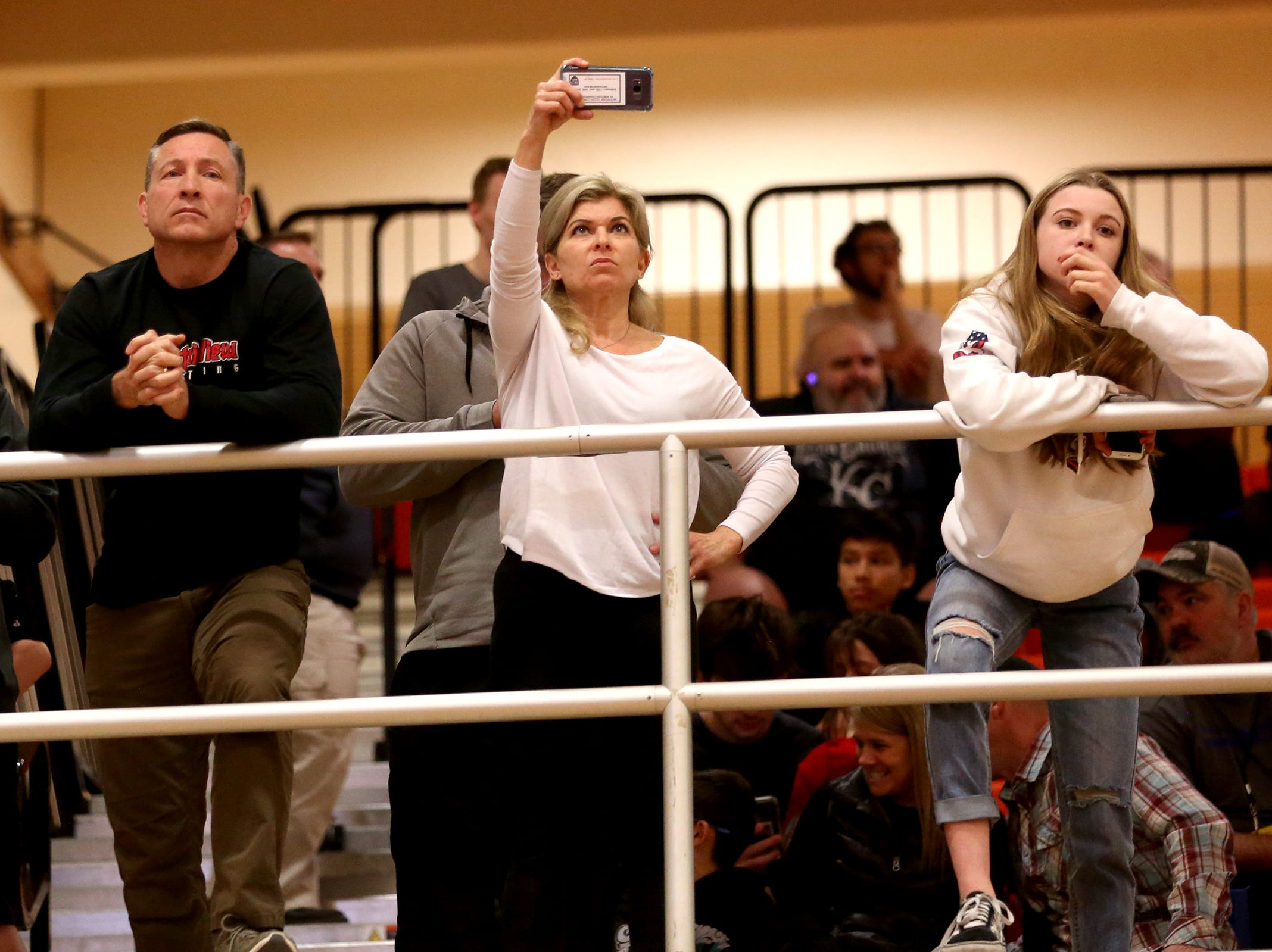 Spectators watch the Mountain Valley Conference district wrestling tournament at Sprague High School in Salem on Friday, Feb. 15, 2019.