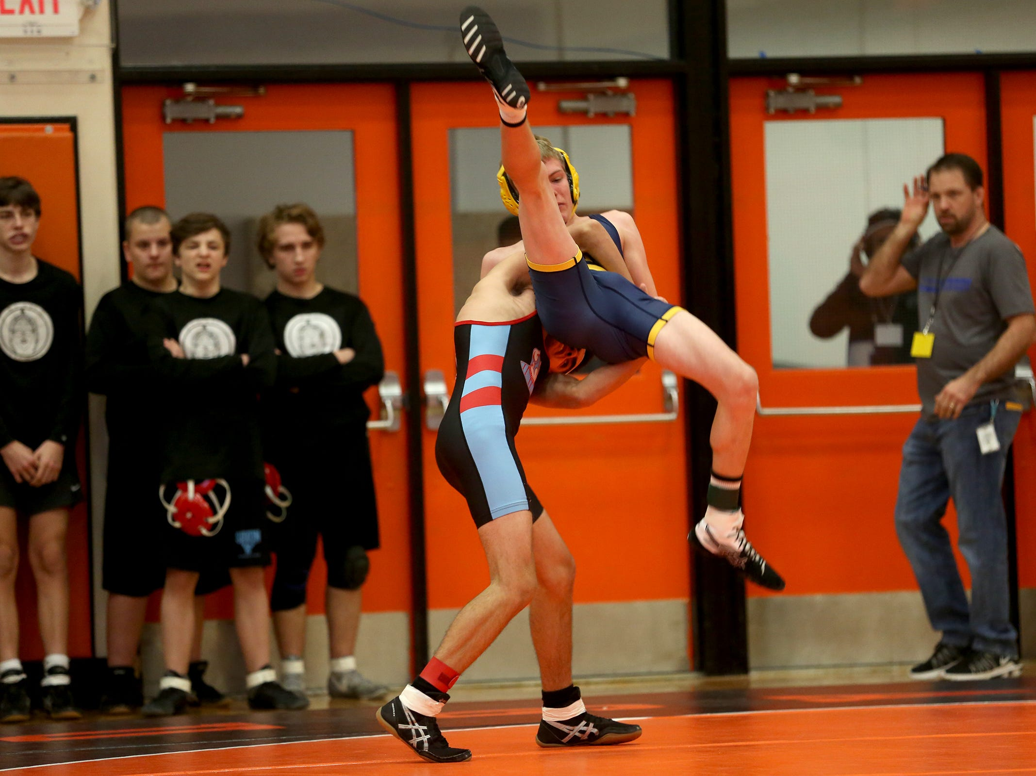 South Salem's Hunter Downs-Getchell picks up Bend's Isaiah Todd as they compete in the 113 weight class during the Mountain Valley Conference district wrestling tournament at Sprague High School in Salem on Friday, Feb. 15, 2019.