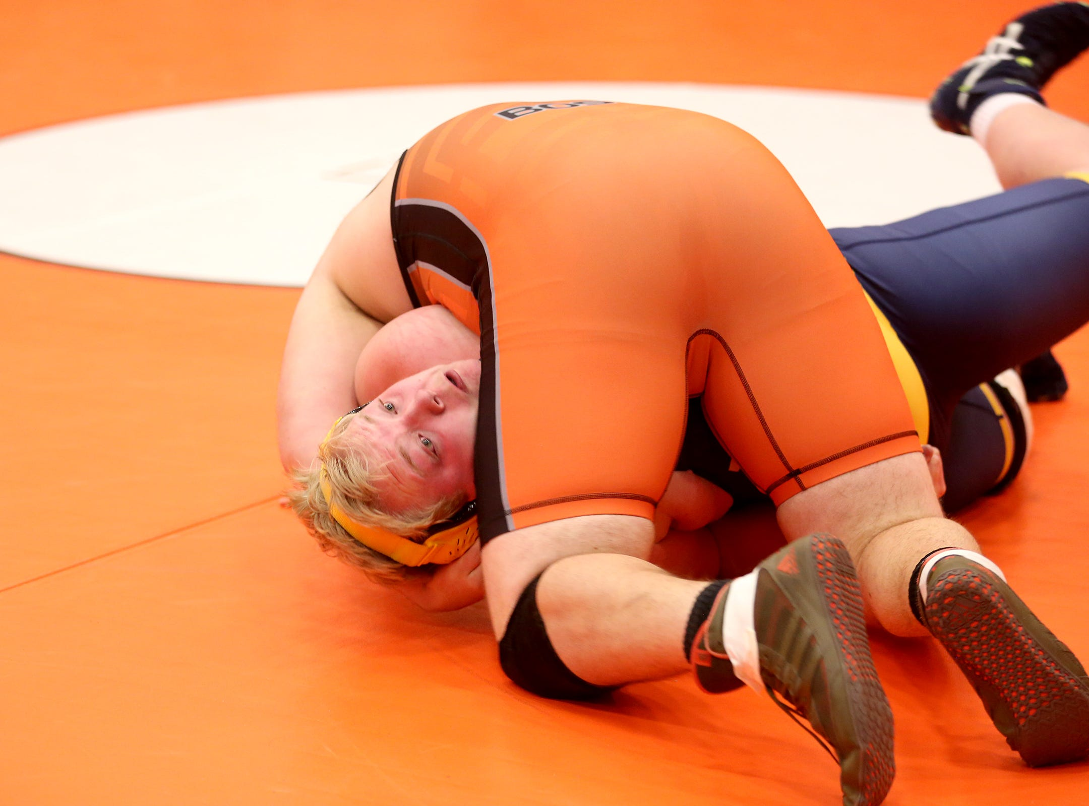 Sprague's Jacob Bos takes control over Bend's Isaac Caldwell as they compete in the 285 pound weight class during the Mountain Valley Conference district wrestling tournament at Sprague High School in Salem on Friday, Feb. 15, 2019.