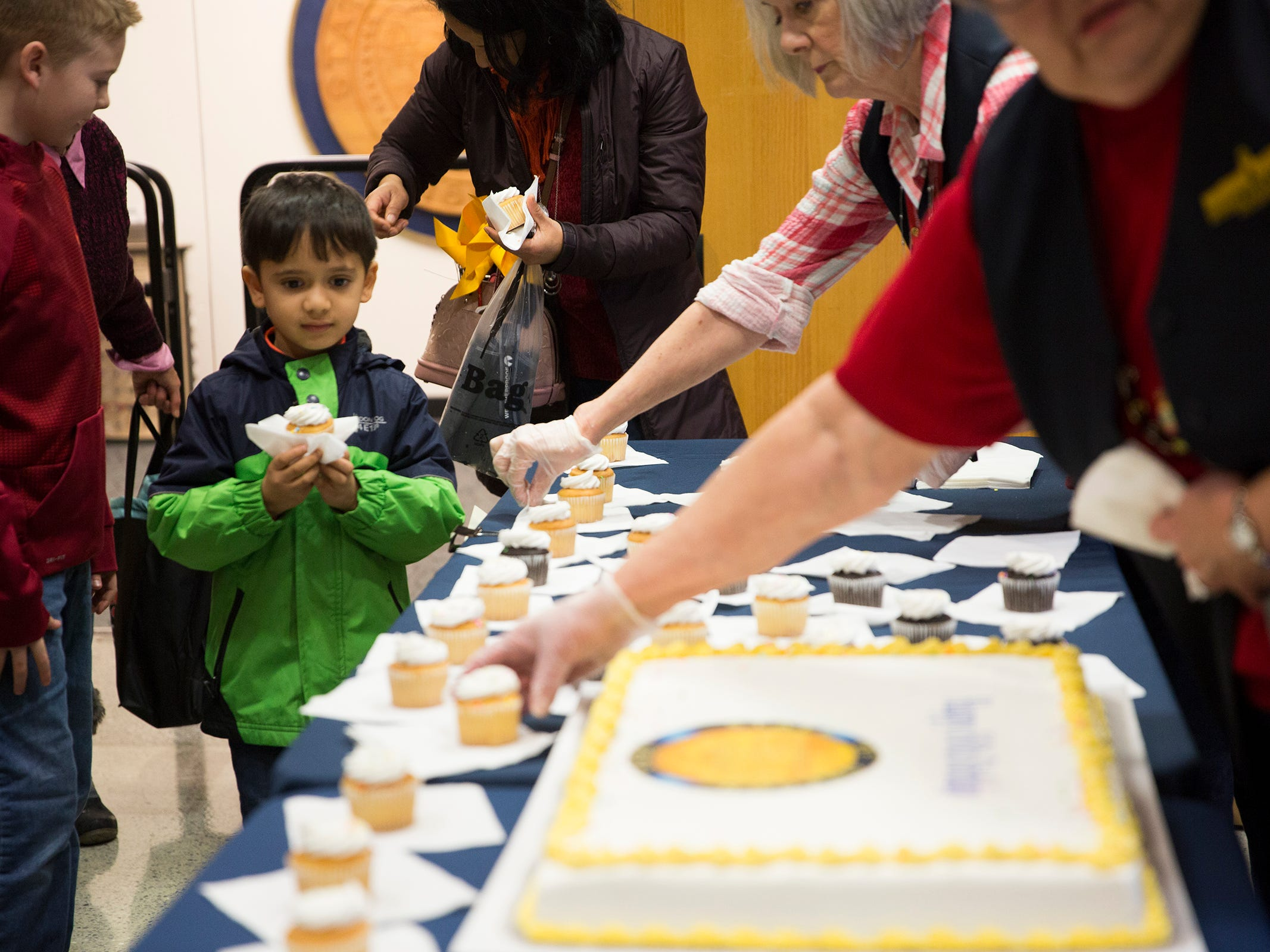 Rohan Pathak, 5, picks out a cupcake during Oregon's 160th Birthday Celebration at the Oregon State Capitol in Salem on Saturday, Feb. 16, 2019.