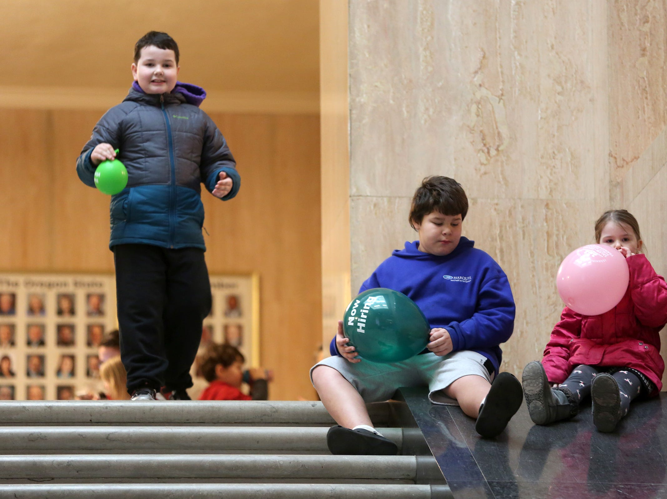 Jack McNabb, 9, William Bothum, 11 and Sierra McNabb, 7, play with balloons during Oregon's 160th Birthday Celebration at the Oregon State Capitol in Salem on Saturday, Feb. 16, 2019.