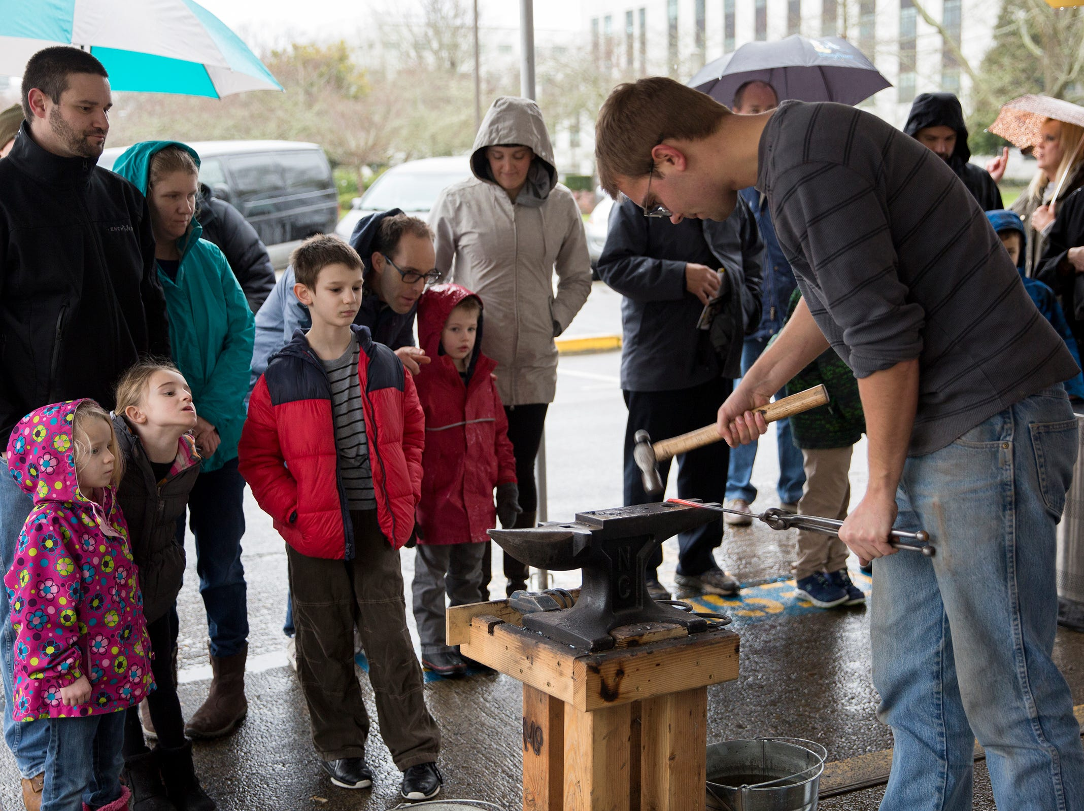 Anvil Academy blacksmith assistant Erik Keyser gives a demonstration of the program that teaches young adults woodworking and blacksmithing during Oregon's 160th Birthday Celebration at the Oregon State Capitol in Salem on Saturday, Feb. 16, 2019.