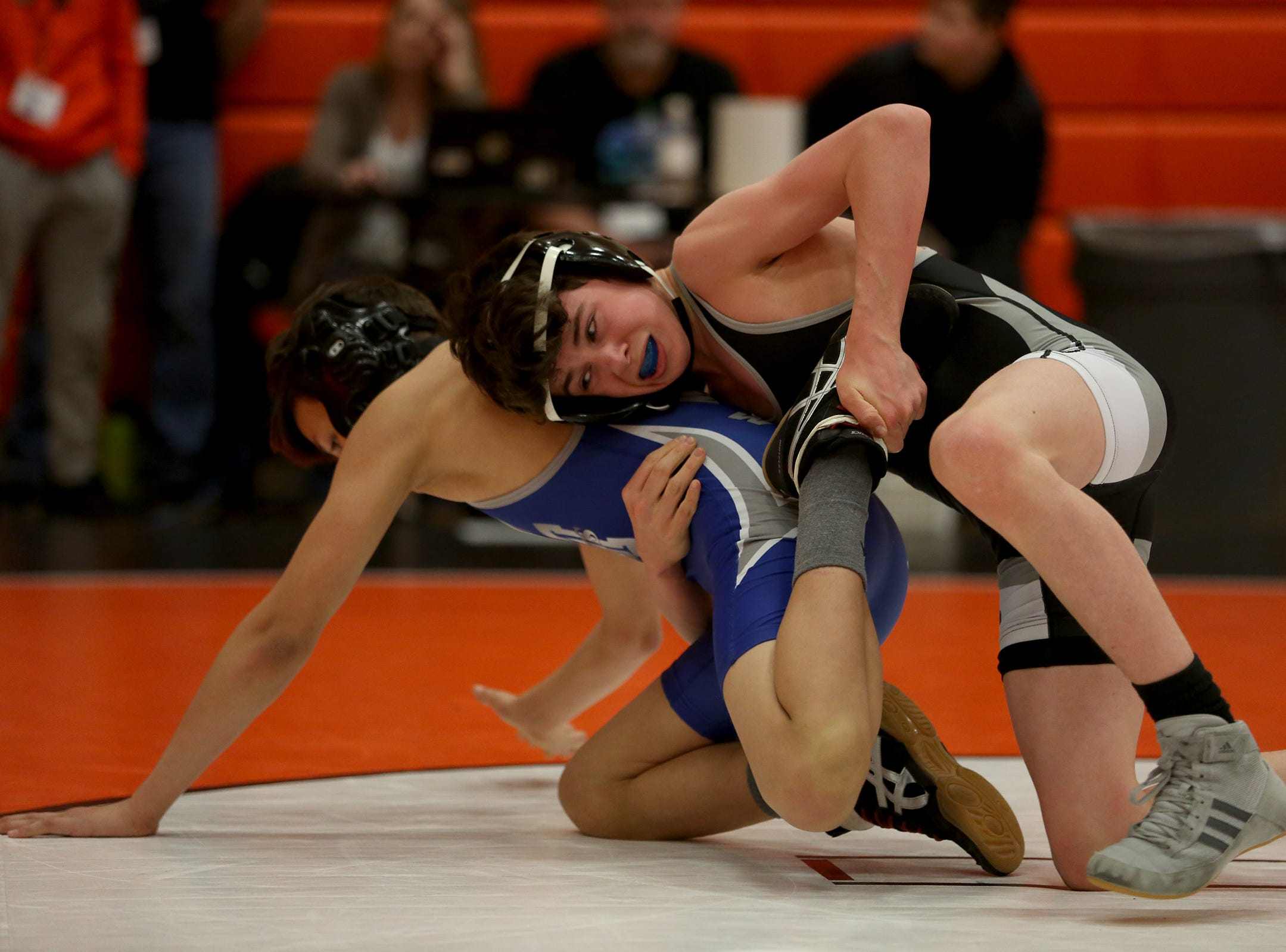 Summit's Jaden Root (right) and McNary's Eoan Sharabarin compete in the 106 pound weight class during the Mountain Valley Conference district wrestling tournament at Sprague High School in Salem on Friday, Feb. 15, 2019.