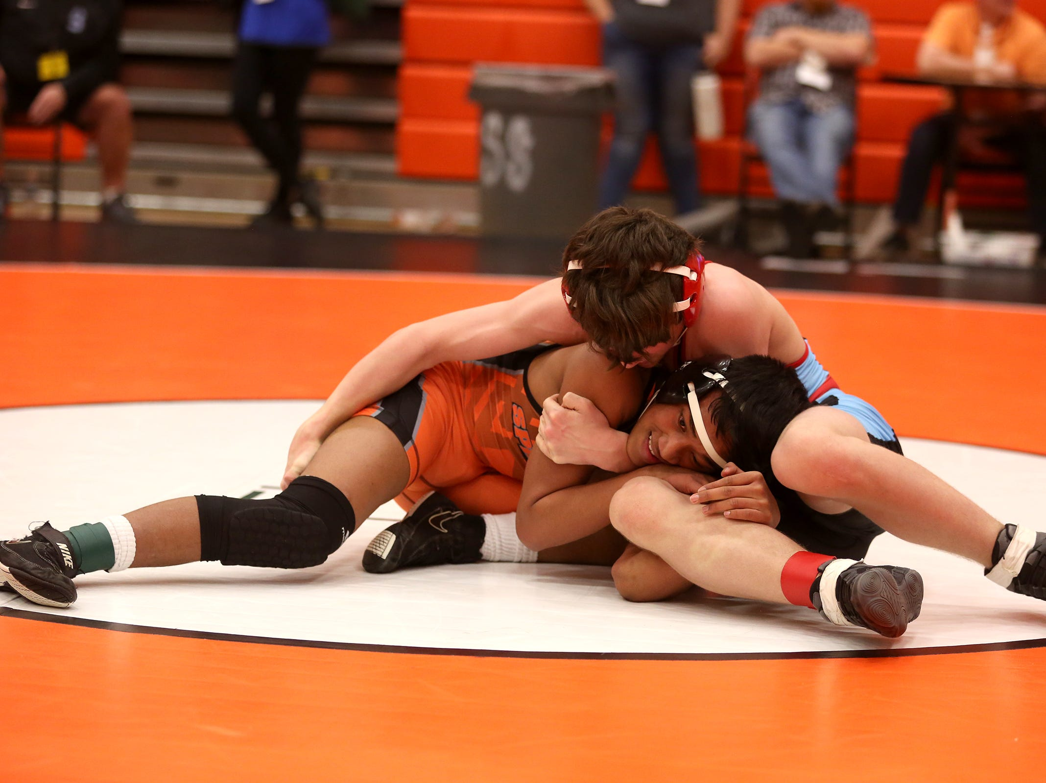 South Salem's Joshua Cox and Sprague's Jason Note compete in the 126 pound weight class during the Mountain Valley Conference district wrestling tournament at Sprague High School in Salem on Friday, Feb. 15, 2019.