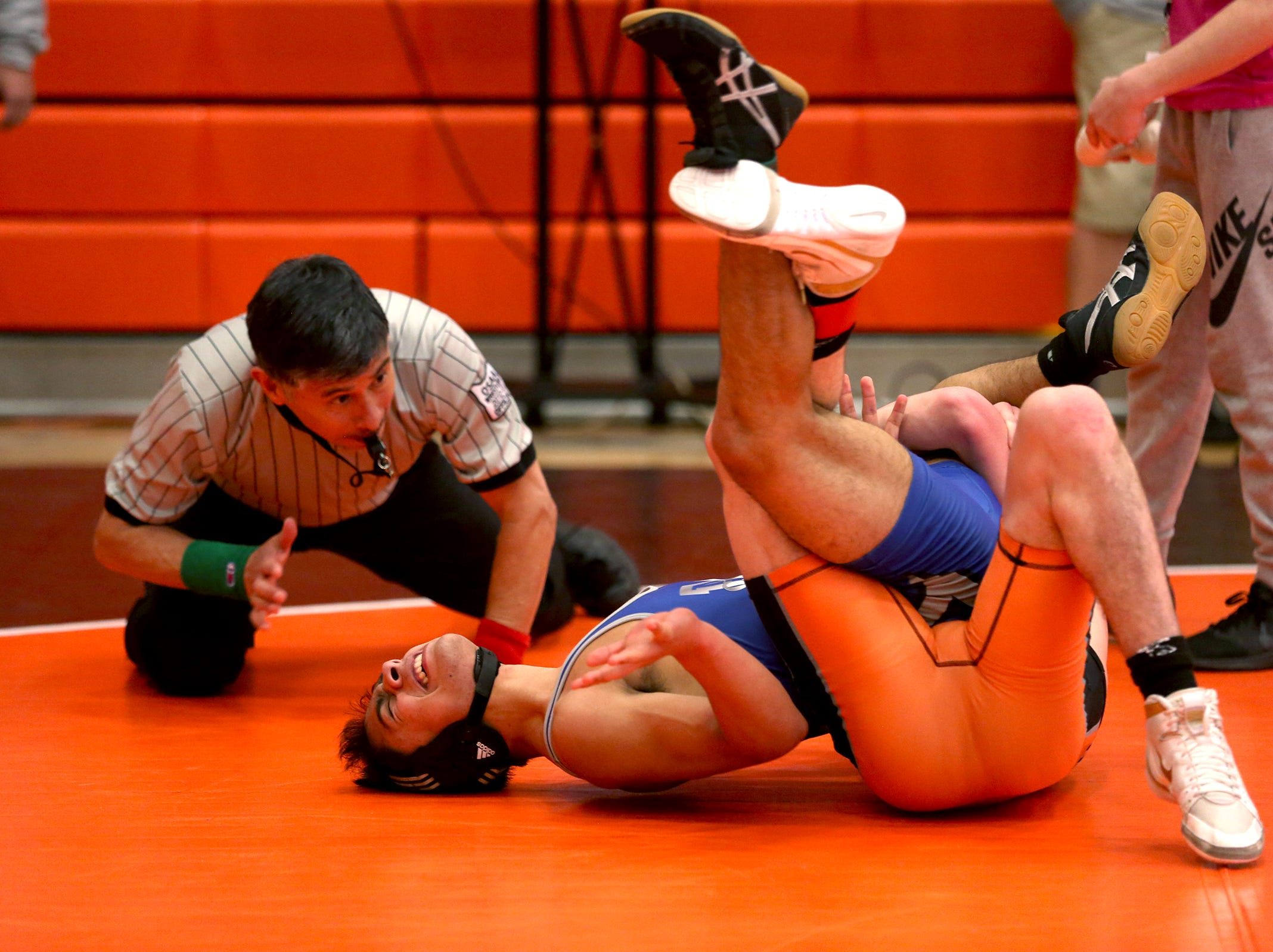 Sprague's Brock McMullen takes control over McNary's Esteban Victoria as they compete in the 132 pound weight class during the Mountain Valley Conference district wrestling tournament at Sprague High School in Salem on Friday, Feb. 15, 2019.