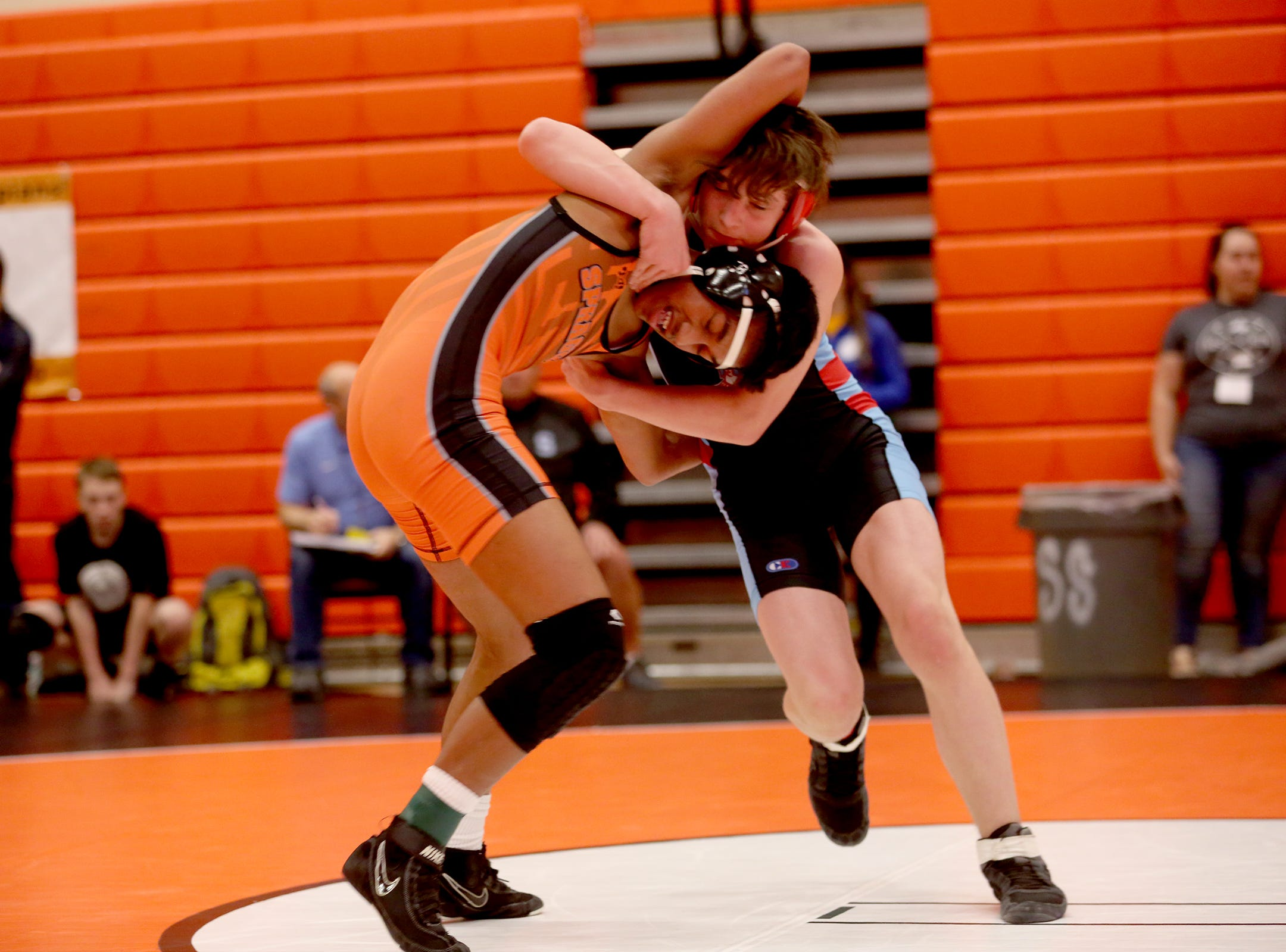 South Salem's Joshua Cox holds down Sprague's Jason Note as they compete in the 126 pound weight class during the Mountain Valley Conference district wrestling tournament at Sprague High School in Salem on Friday, Feb. 15, 2019.