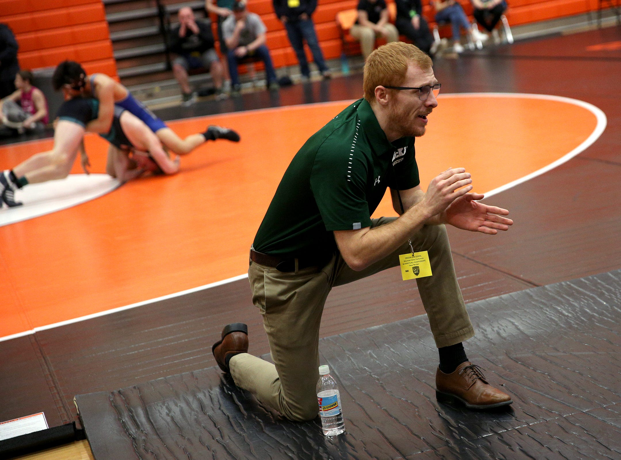 McKay High School head wrestling coach Eric Harder calls out to one of his wrestlers during the Mountain Valley Conference district wrestling tournament at Sprague High School in Salem on Friday, Feb. 15, 2019.