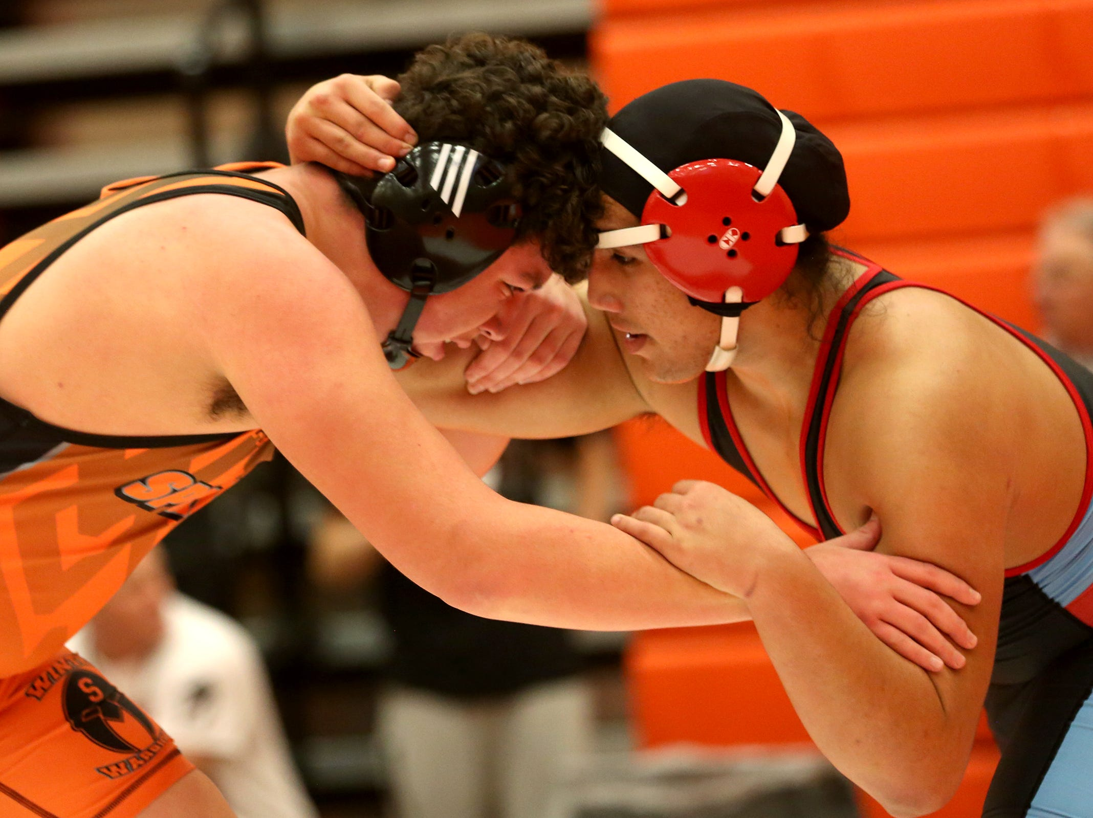 Sprague's David Shearman (left) and South Salem's Sangato Letisi compete in the 220 pound weight class during the Mountain Valley Conference district wrestling tournament at Sprague High School in Salem on Friday, Feb. 15, 2019.