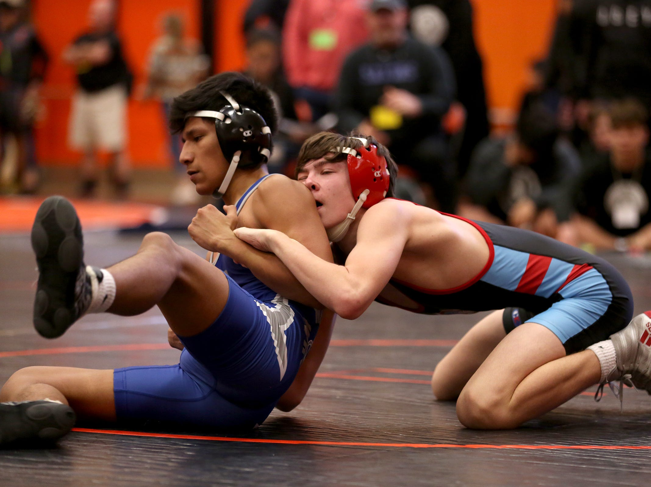 McNary's Daniel Hernandez and South Salem's Hunter Harrison (right) compete in the 126 pound weight class during the Mountain Valley Conference district wrestling tournament at Sprague High School in Salem on Friday, Feb. 15, 2019.