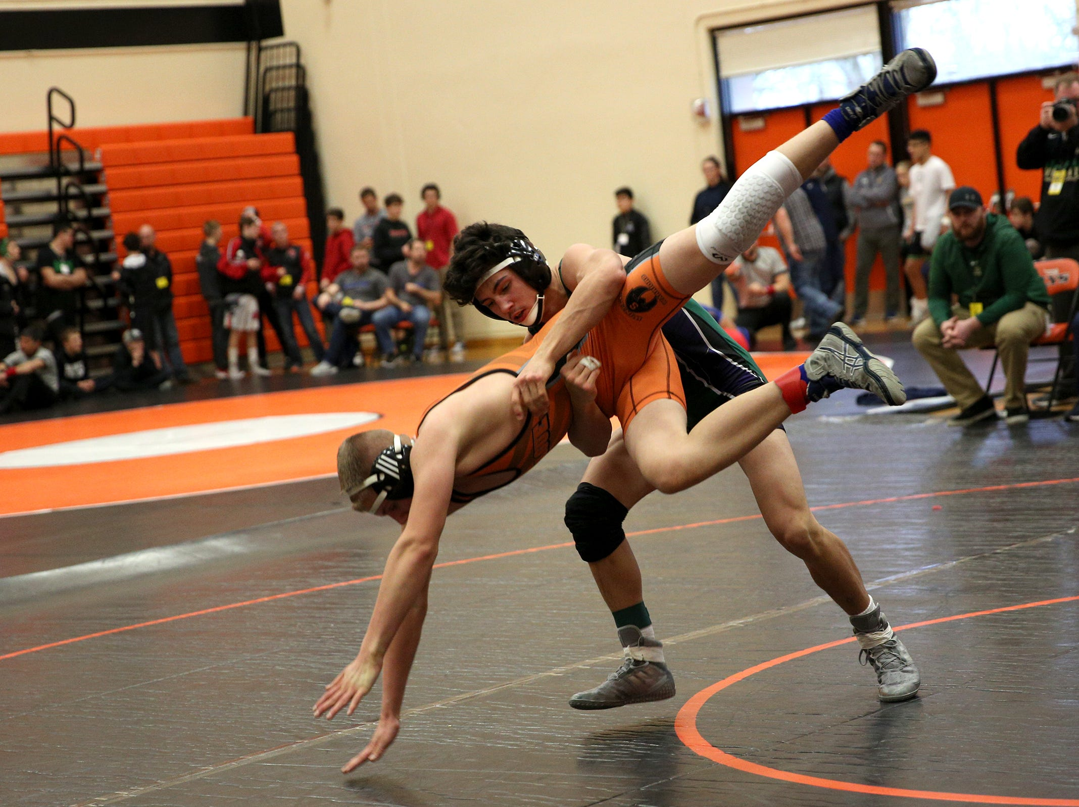 McKay's Gavin Harris throws down Sprague's Aiden Walter as they compete in the 145 pound weight class during the Mountain Valley Conference district wrestling tournament at Sprague High School in Salem on Friday, Feb. 15, 2019.