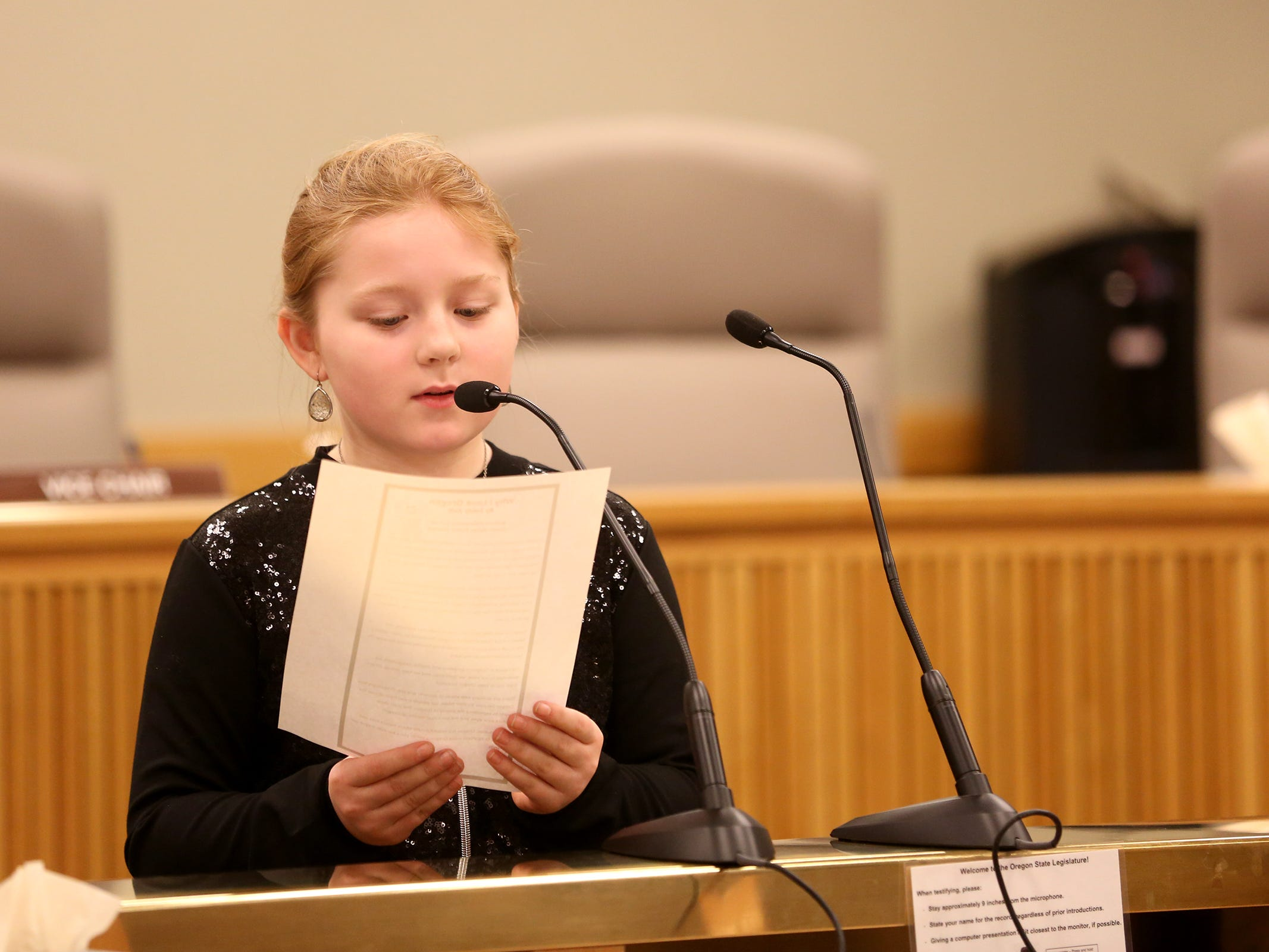 Essay contest winner Emily Ault, 10, reads an essay she wrote on how she sees Oregon during Oregon's 160th Birthday Celebration at the Oregon State Capitol in Salem on Saturday, Feb. 16, 2019.