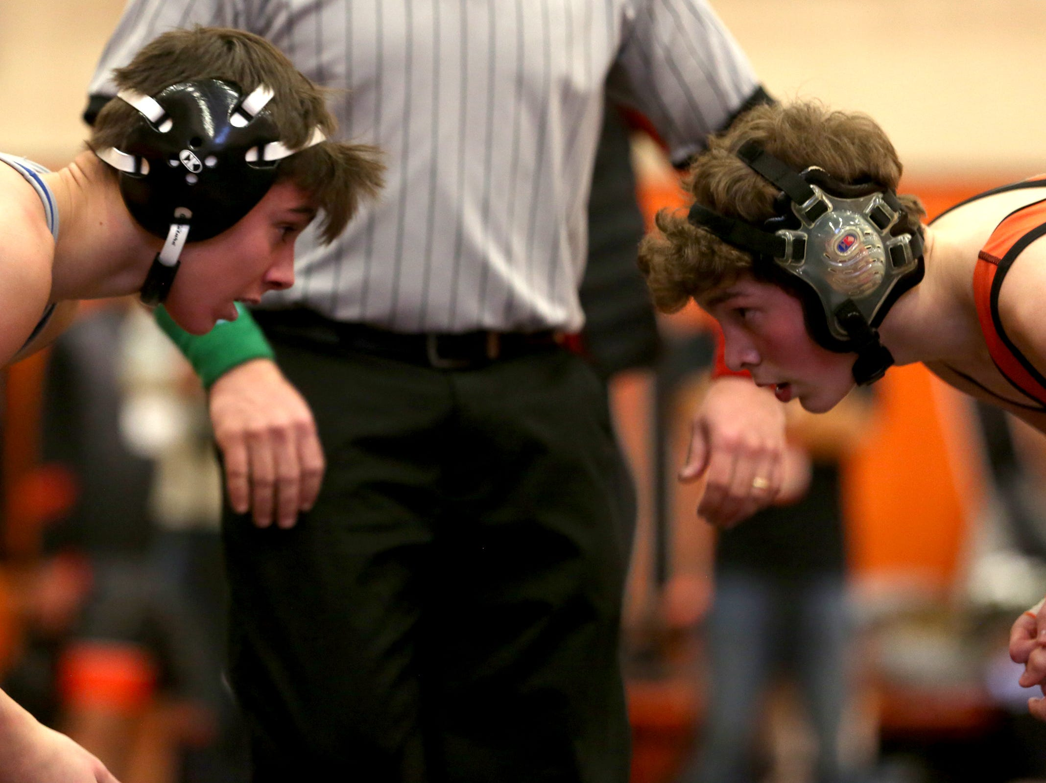 McNary's Noah Gatchet (left) and Sprague's Skyler Lowell compete in the 120 weight class during the Mountain Valley Conference district wrestling tournament at Sprague High School in Salem on Friday, Feb. 15, 2019.