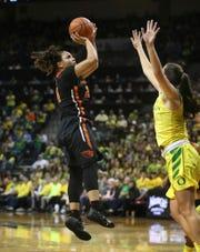 Oregon State's Destiny Slocum, left, shoots over Oregon's Maite Cazorla during the third quarter of an NCAA college basketball game Friday, Feb. 15, 2019, in Eugene, Ore. (AP Photo/Chris Pietsch)