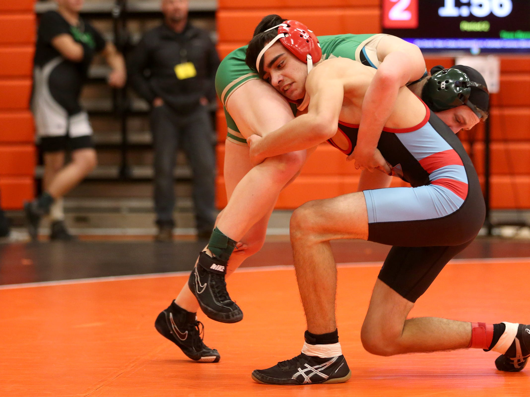 South Salem's Hunter Downs-Getchell (right) takes on McKay's Tess Barnett in the 129 pound weight class during the Mountain Valley Conference district wrestling tournament at Sprague High School in Salem on Friday, Feb. 15, 2019.