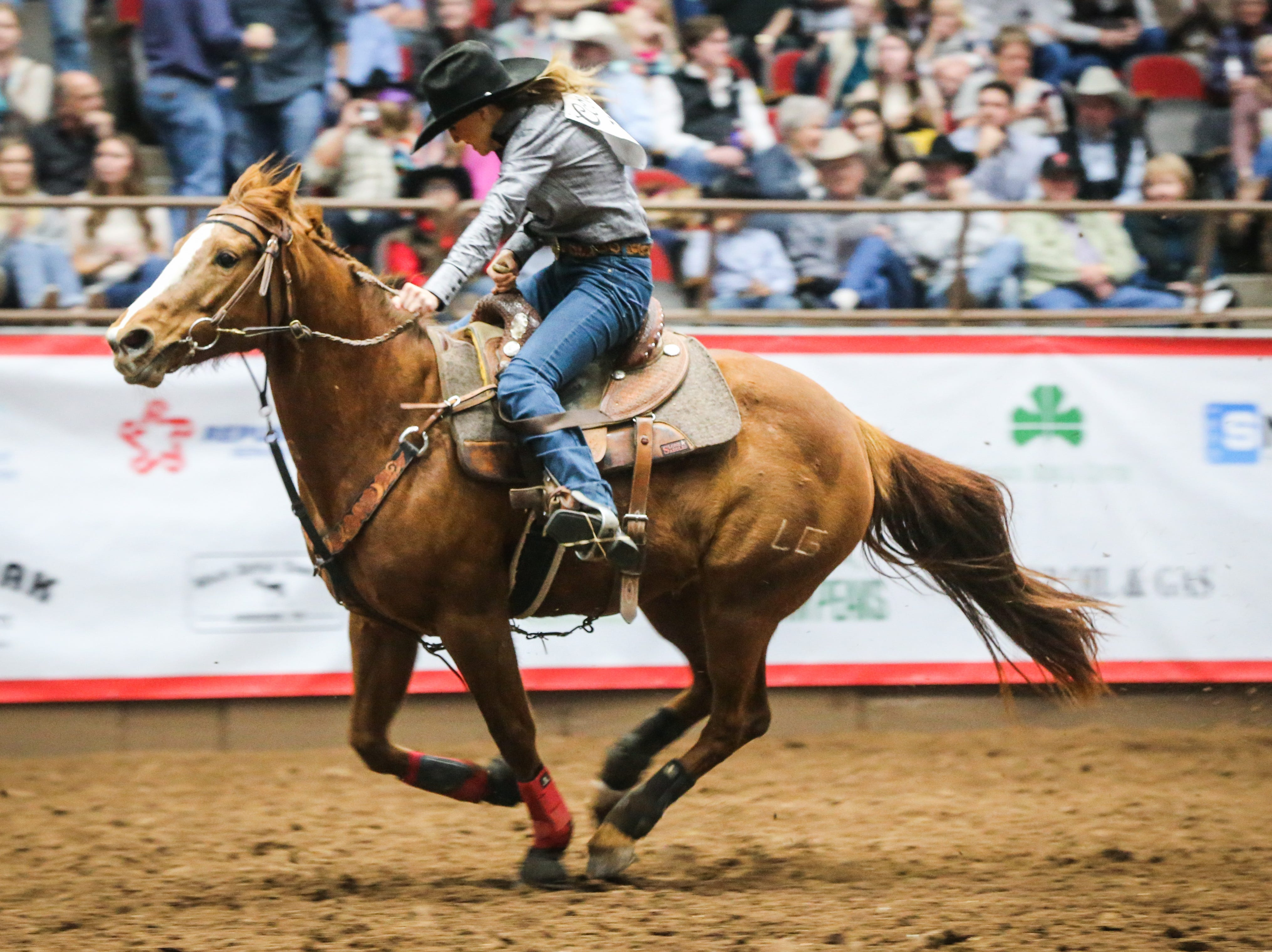 Alex Lang races the barrels during finals of the San Angelo Stock Show & Rodeo Friday, Feb. 15, 2019, at Foster Communications Coliseum.
