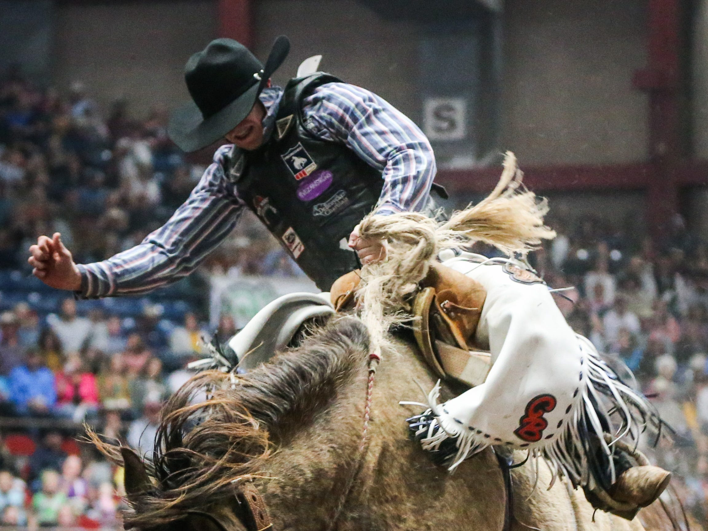 Chase Brooks rides a bronc during finals of the San Angelo Stock Show & Rodeo Friday, Feb. 15, 2019, at Foster Communications Coliseum.